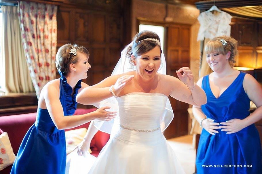 Bride putting on wedding dress 02