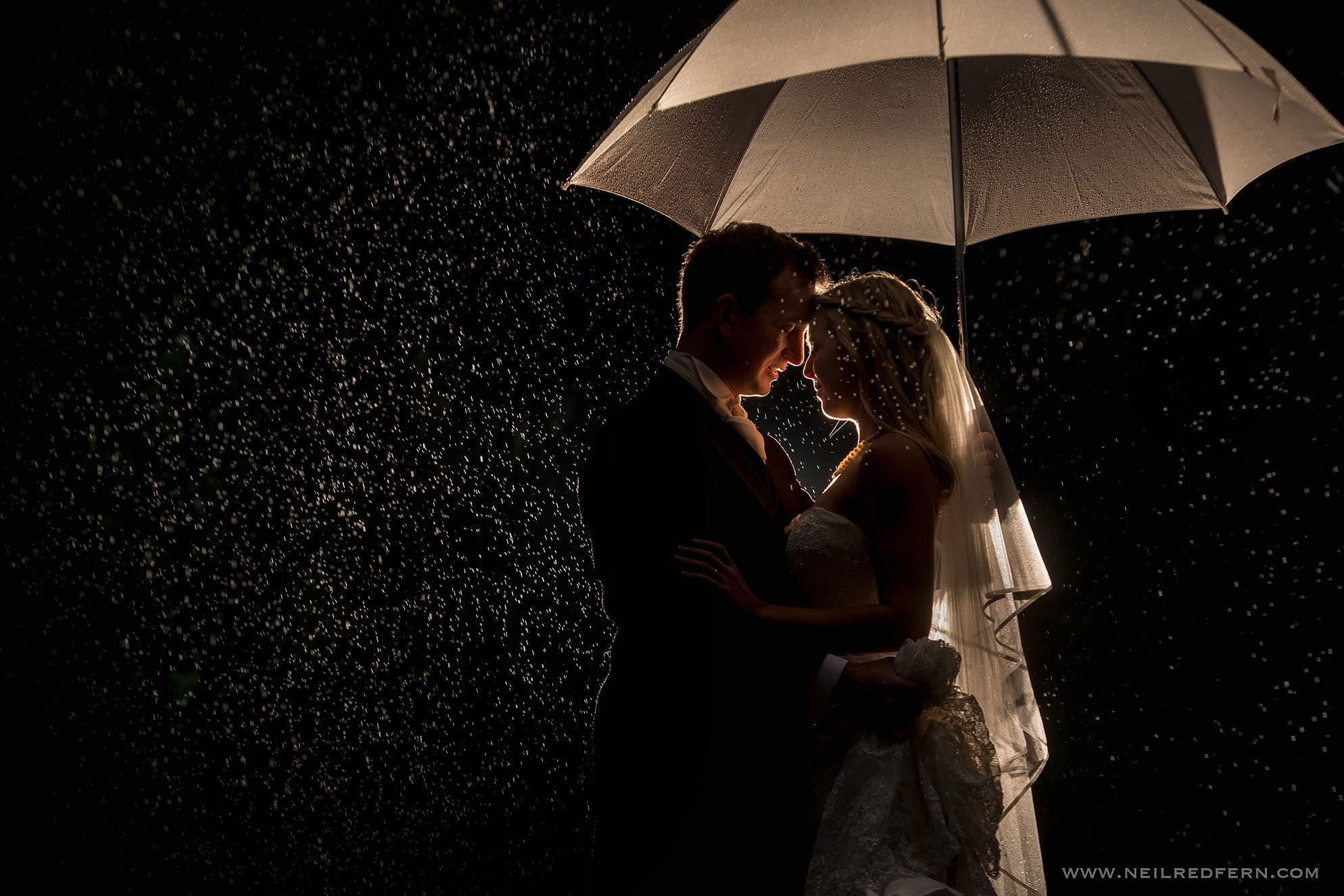 wedding photogragph in the rain