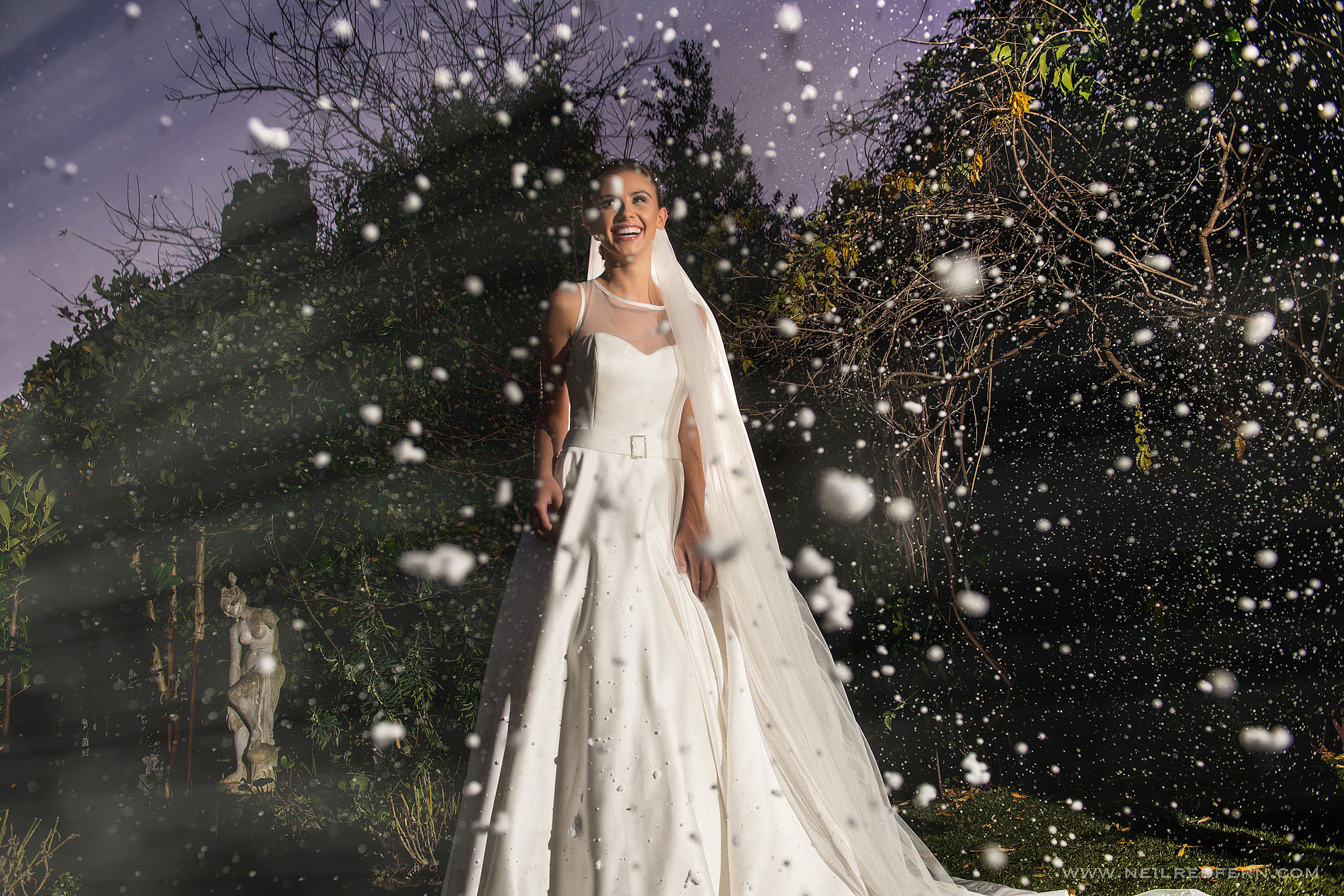 photograph of a bride in the snow