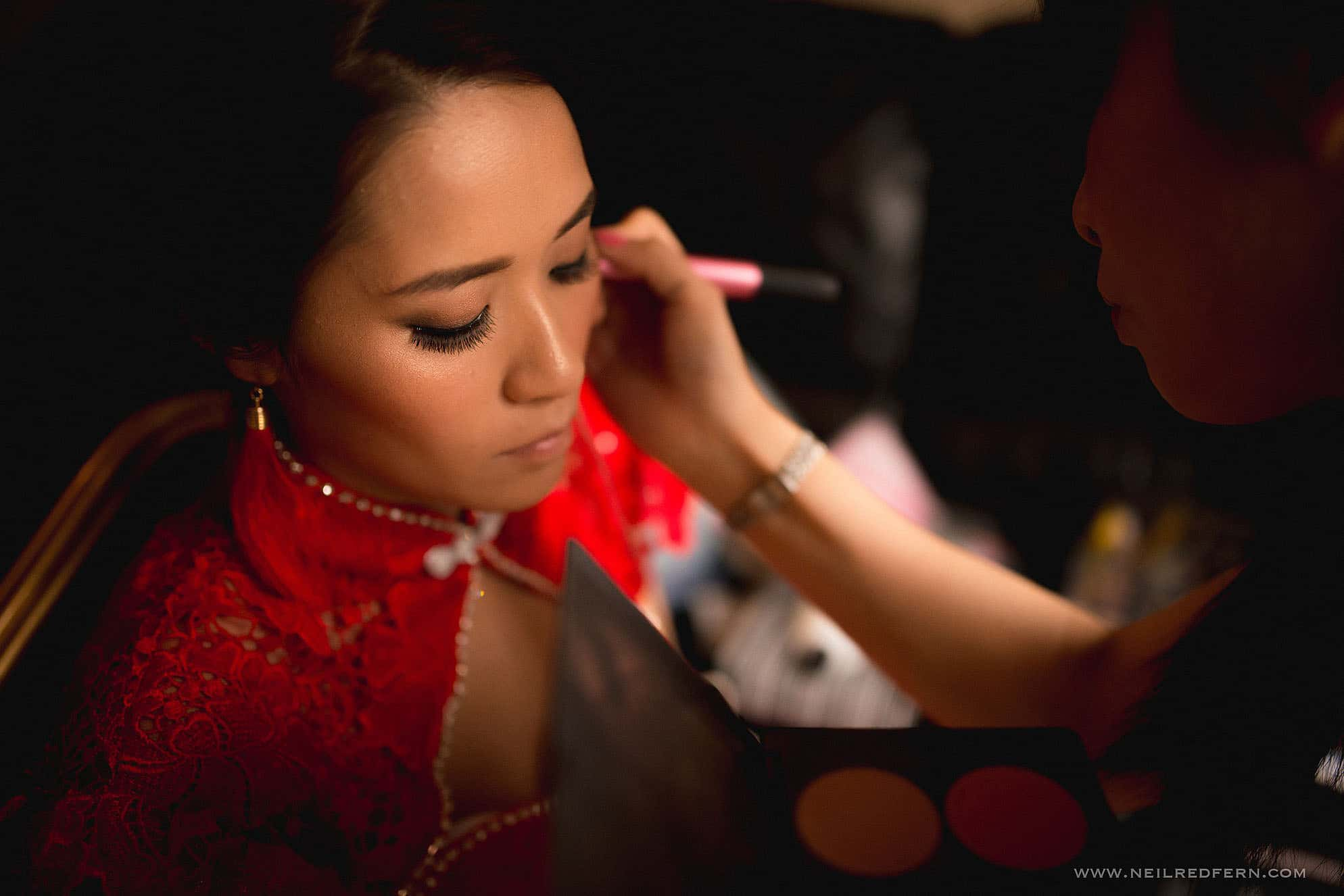 Chinese bride having make up put on