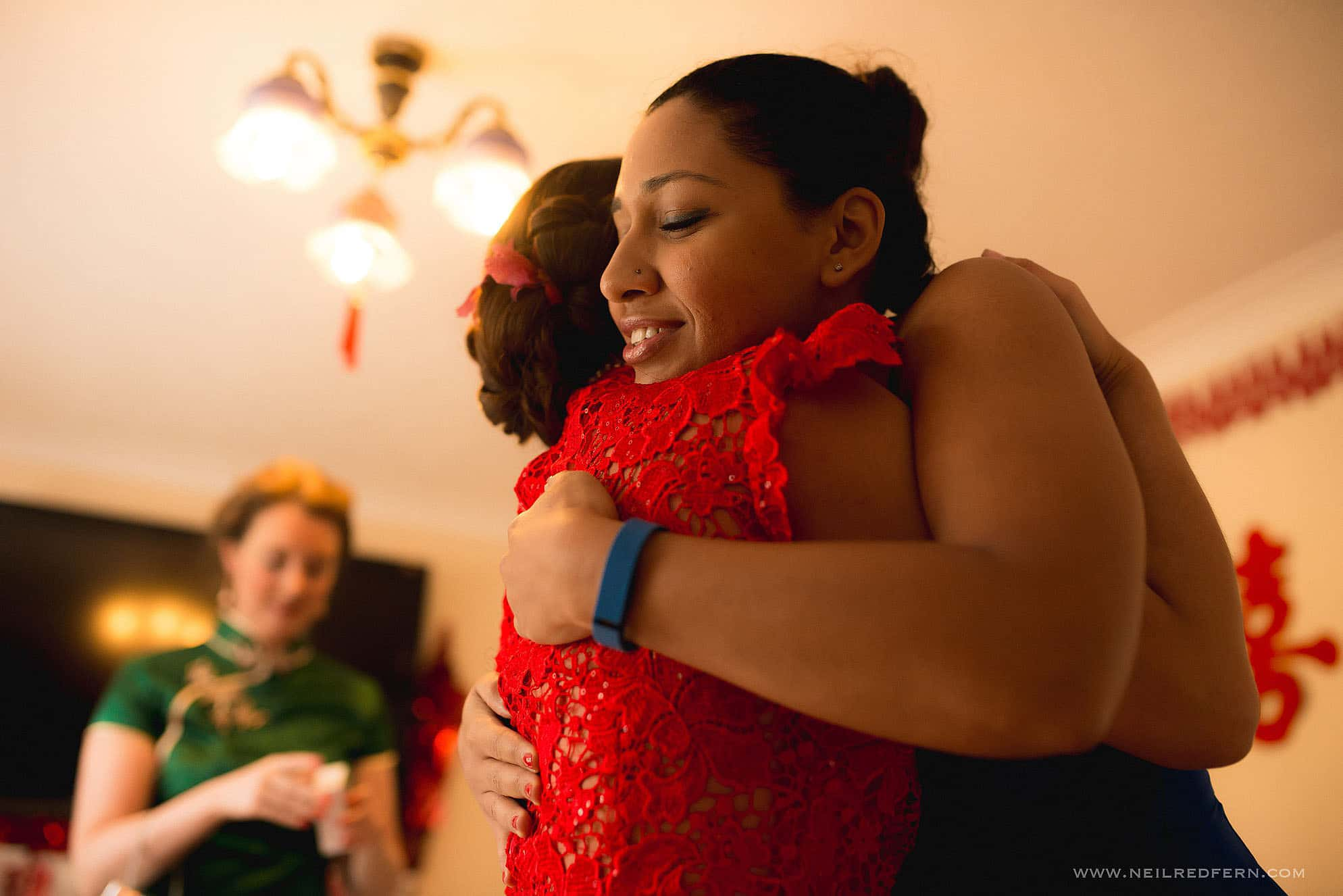bridesmaids hugging at Chinese wedding