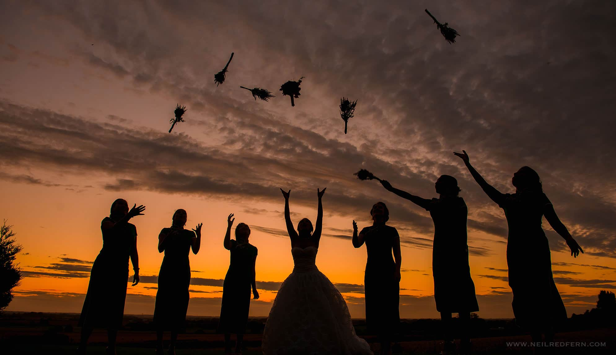 silhouette of bridesmaids at wedding