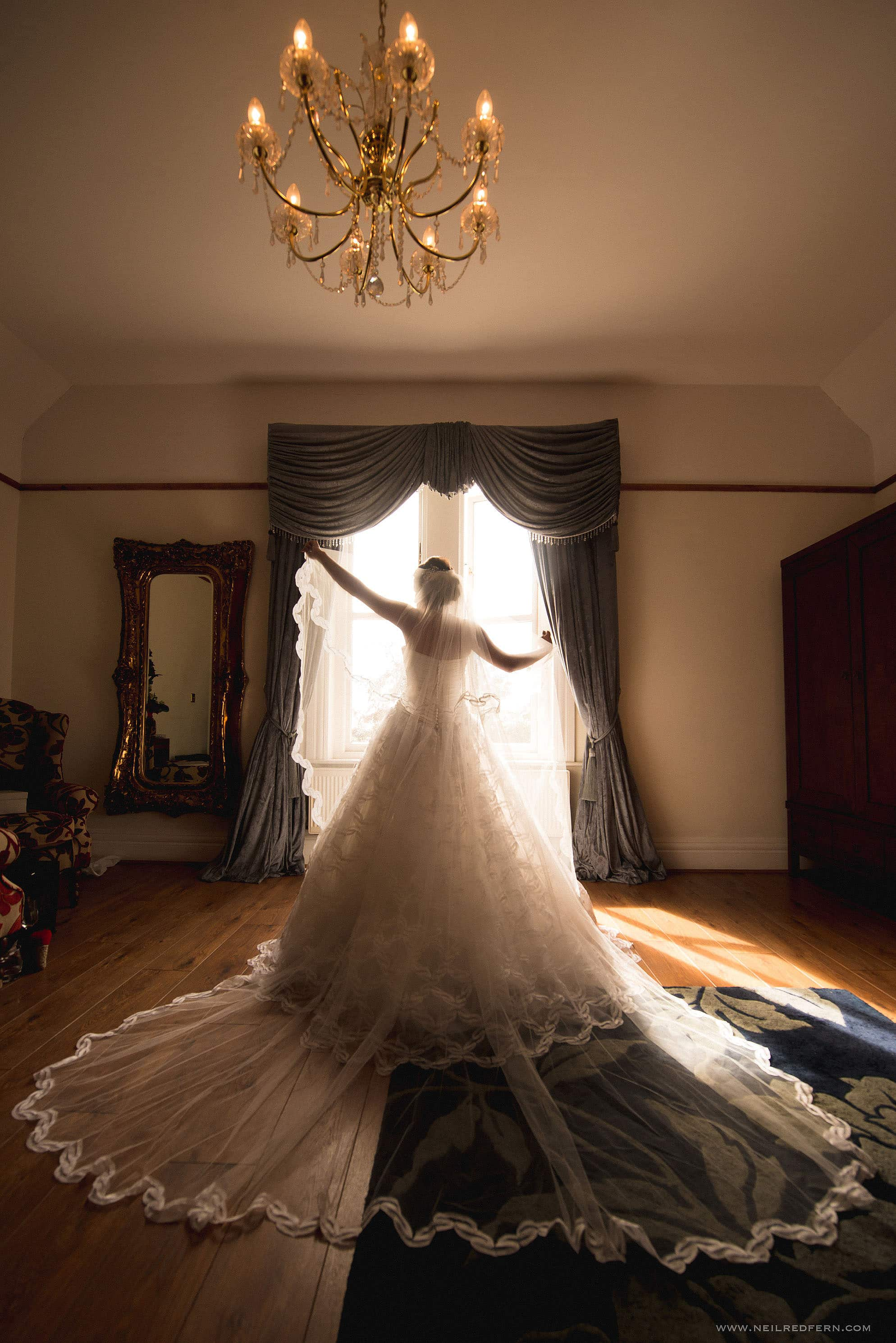 back of wedding dress in front of window
