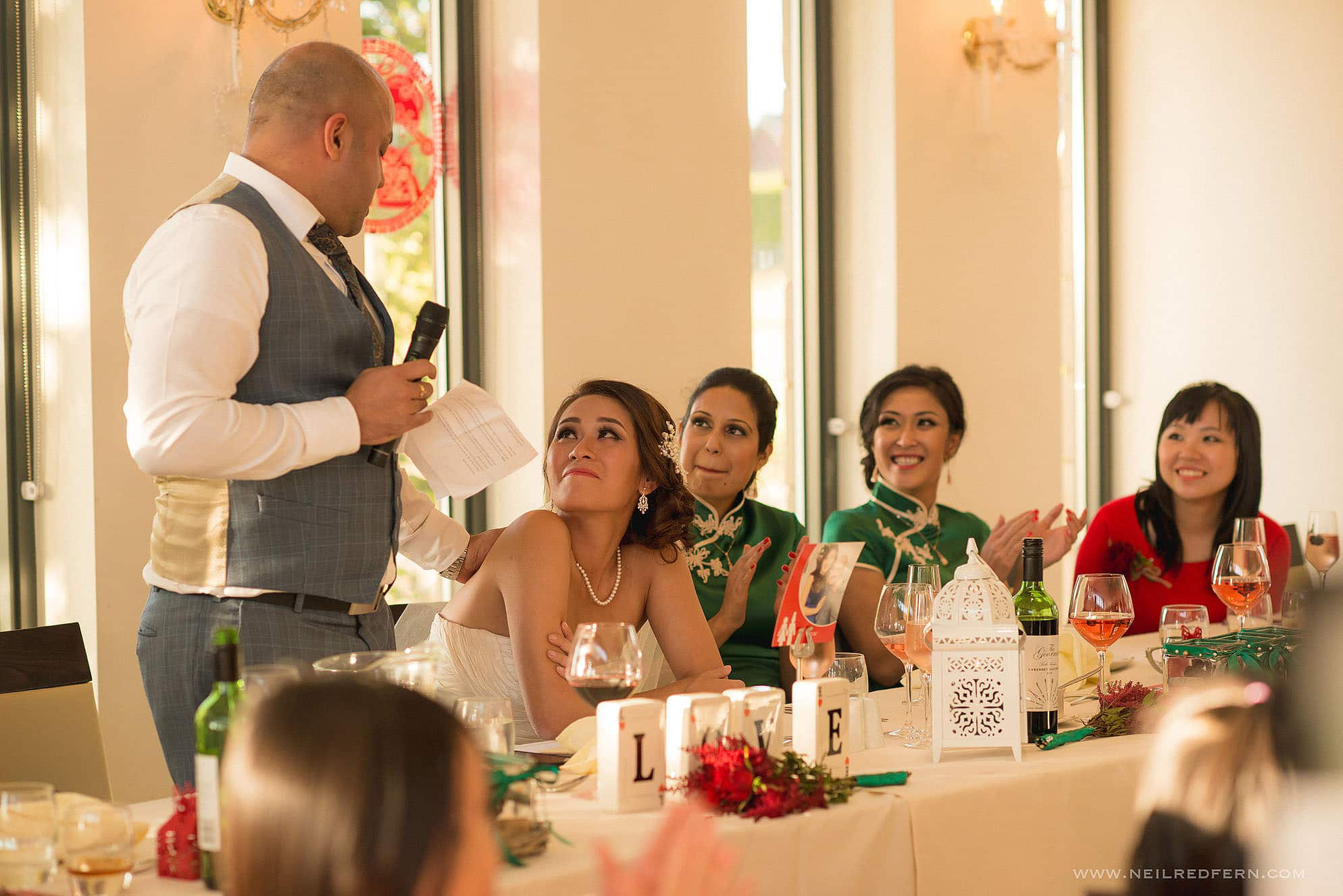 bride looking at groom during speeches
