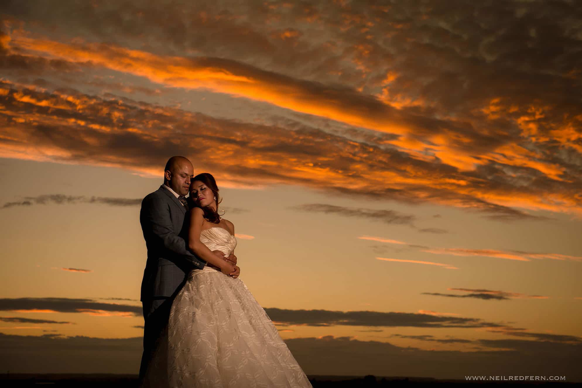 sunset bride and groom portrait at Chinese wedding