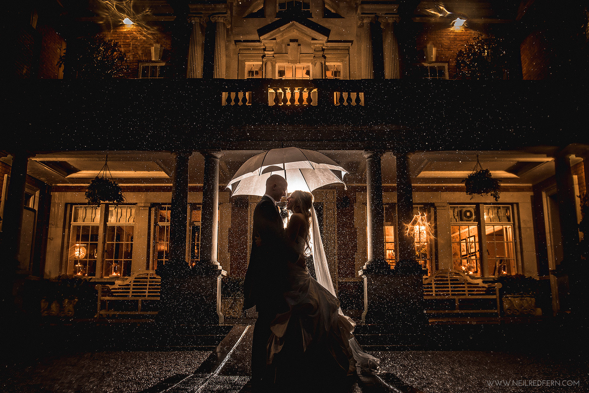 Rain wedding photograph at Eaves Hall