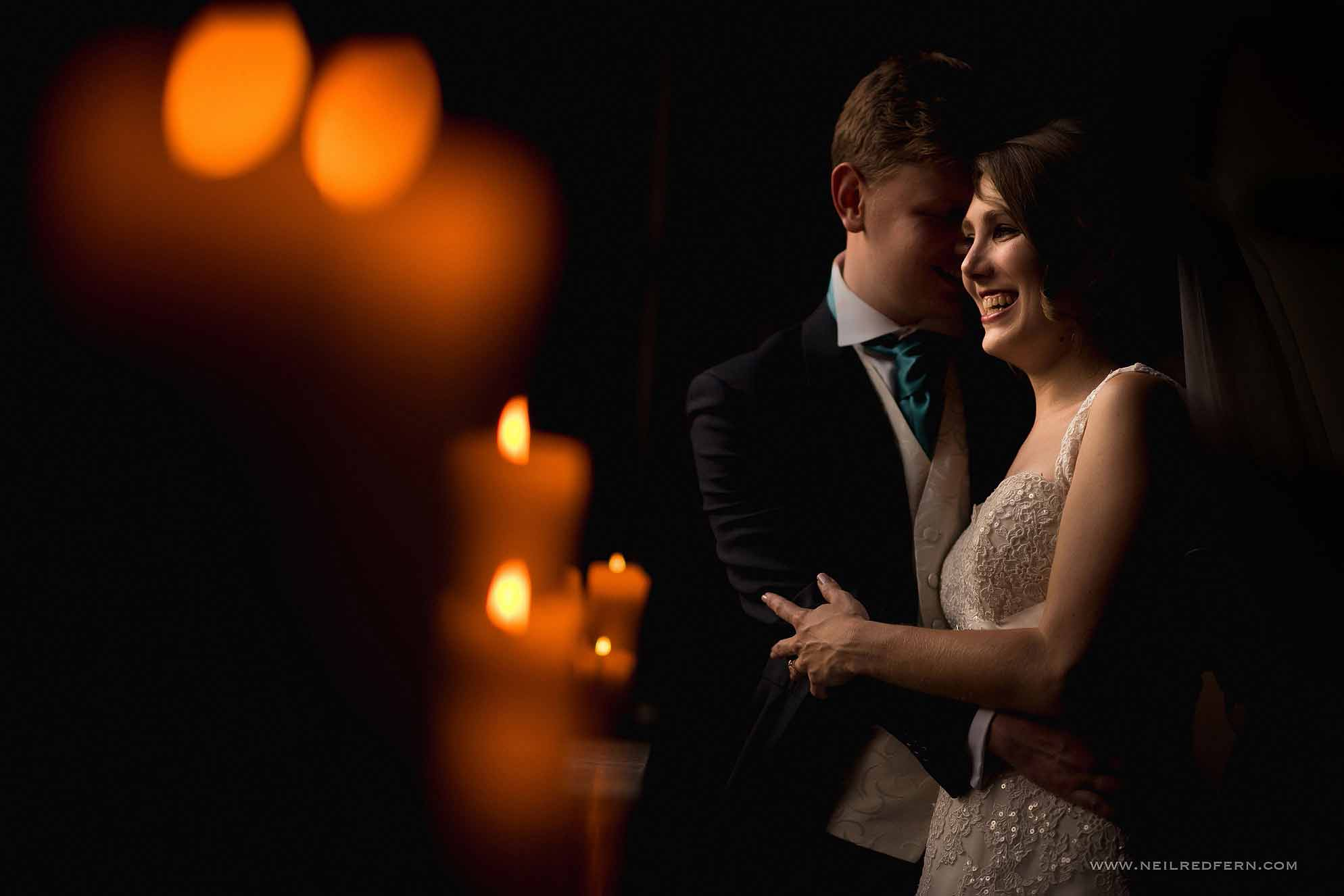 bride and groom photograph with candles