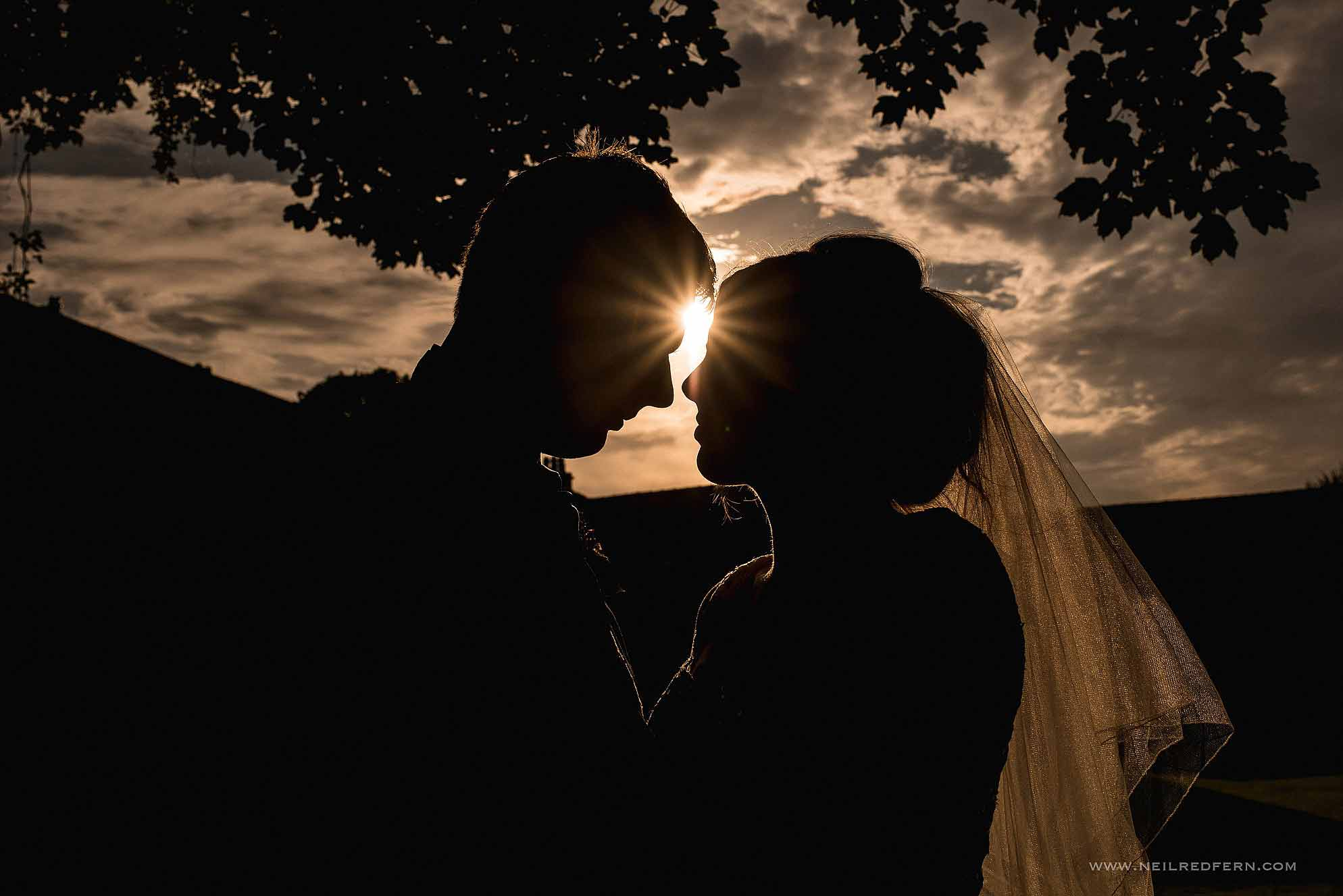 sunset photograph of bride and groom
