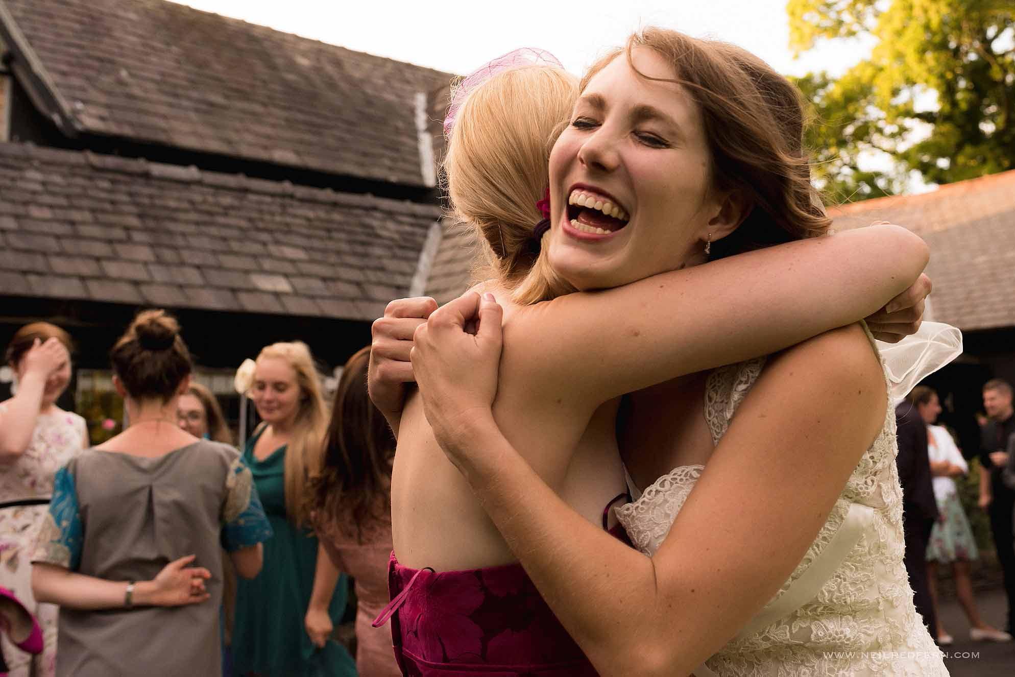 happy bride hugging friend