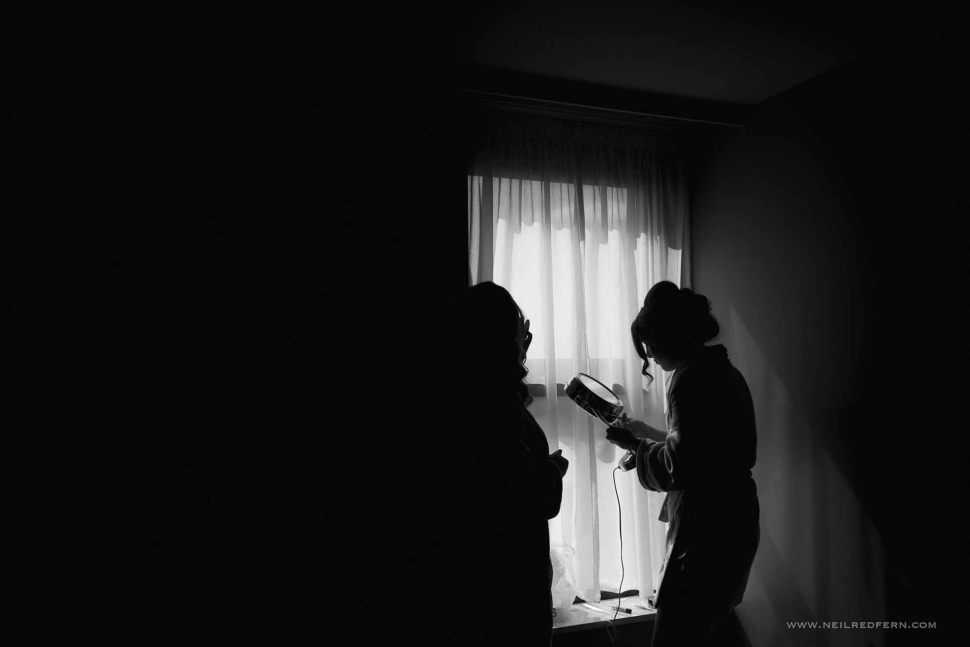 black and white photograph of bride getting ready