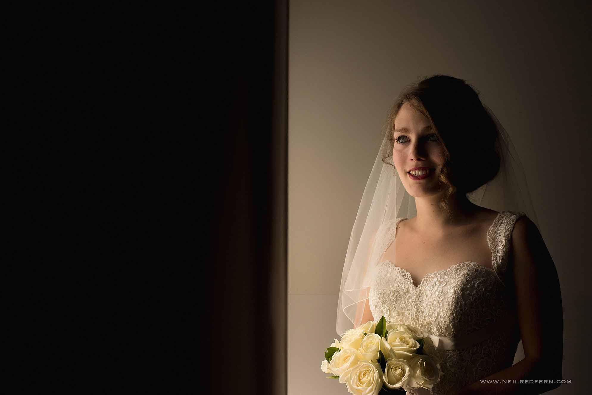portrait of bride stood near window
