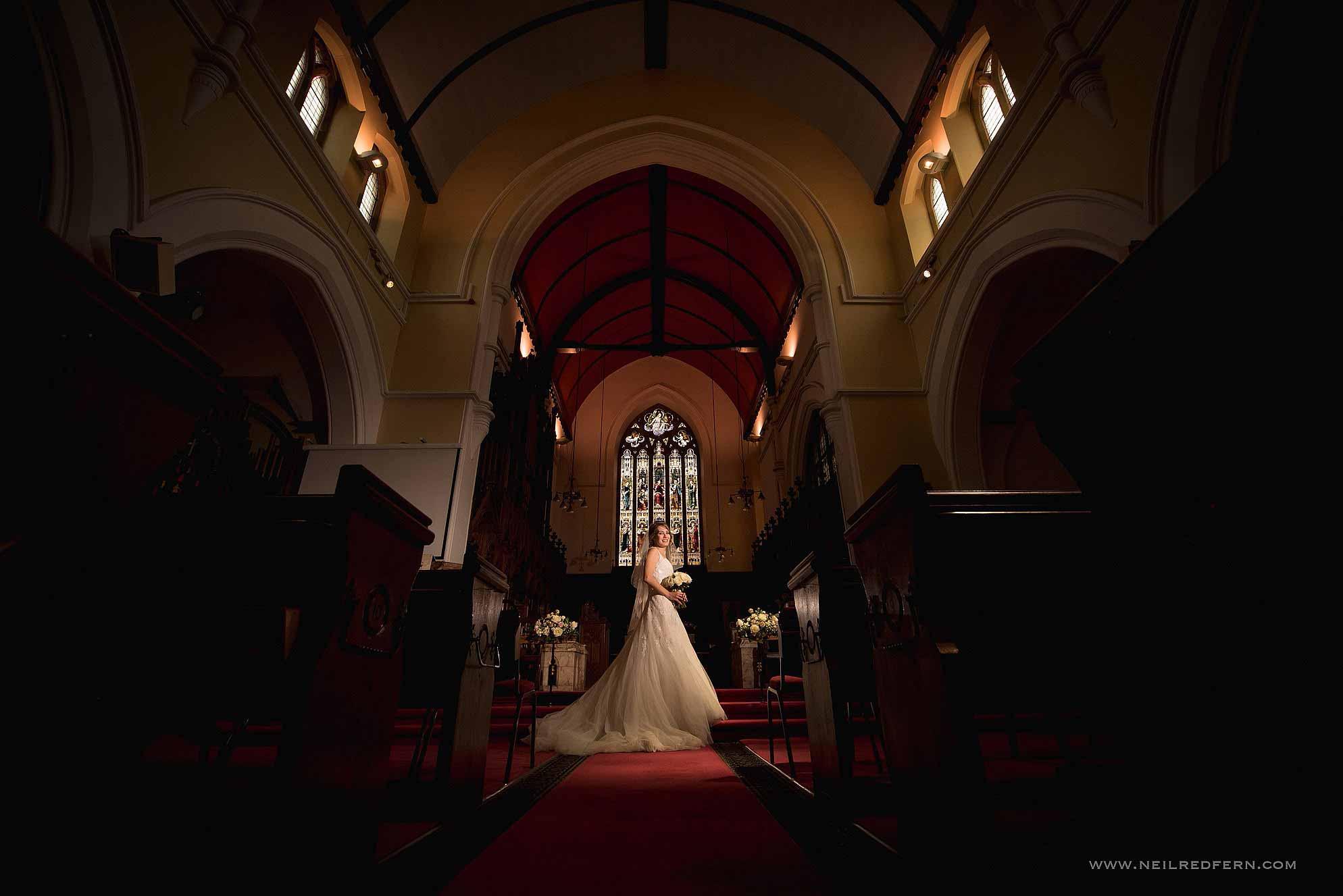 off camera flash photo of bride in church