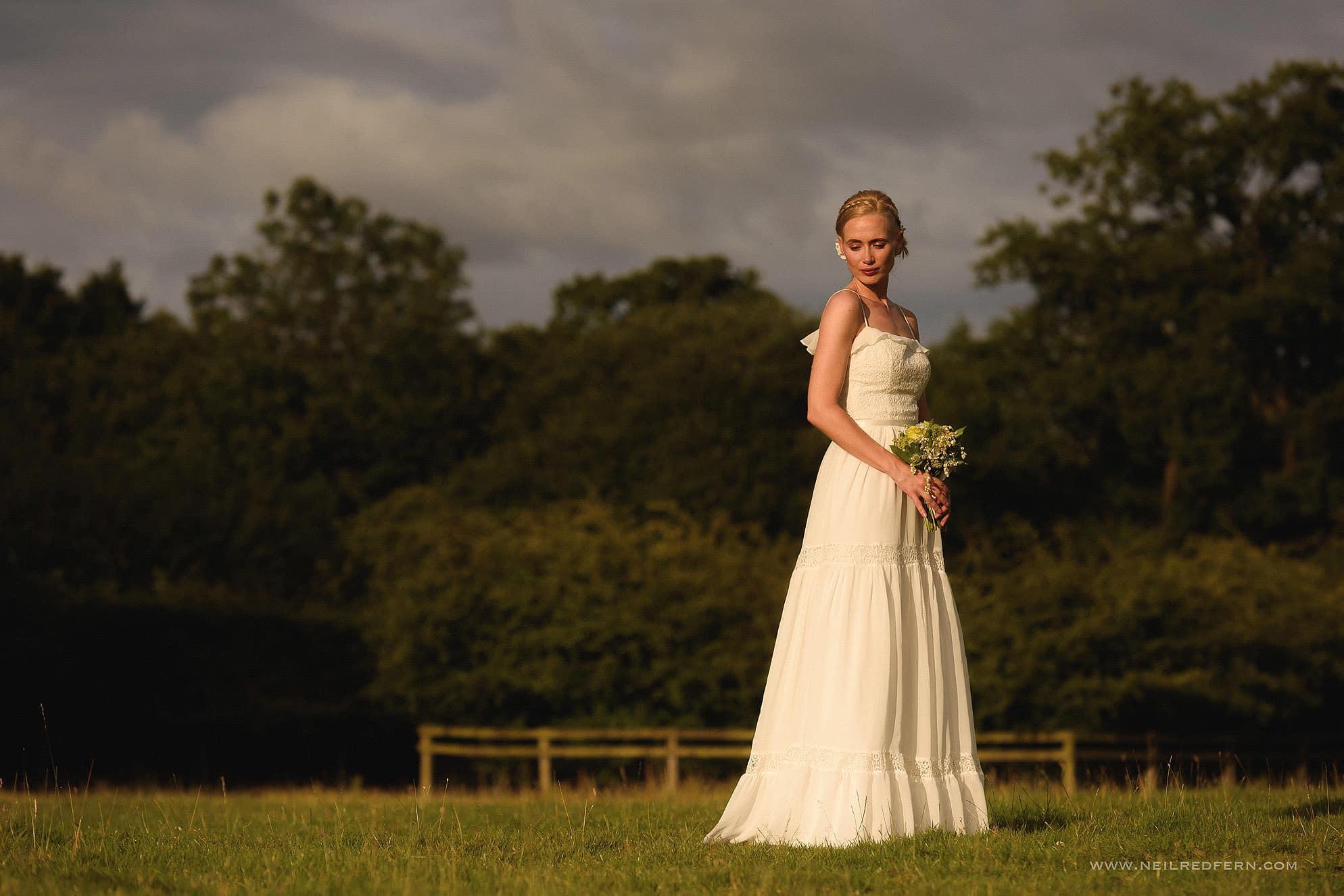 portrait of bride outside Sandhole Oak Barn