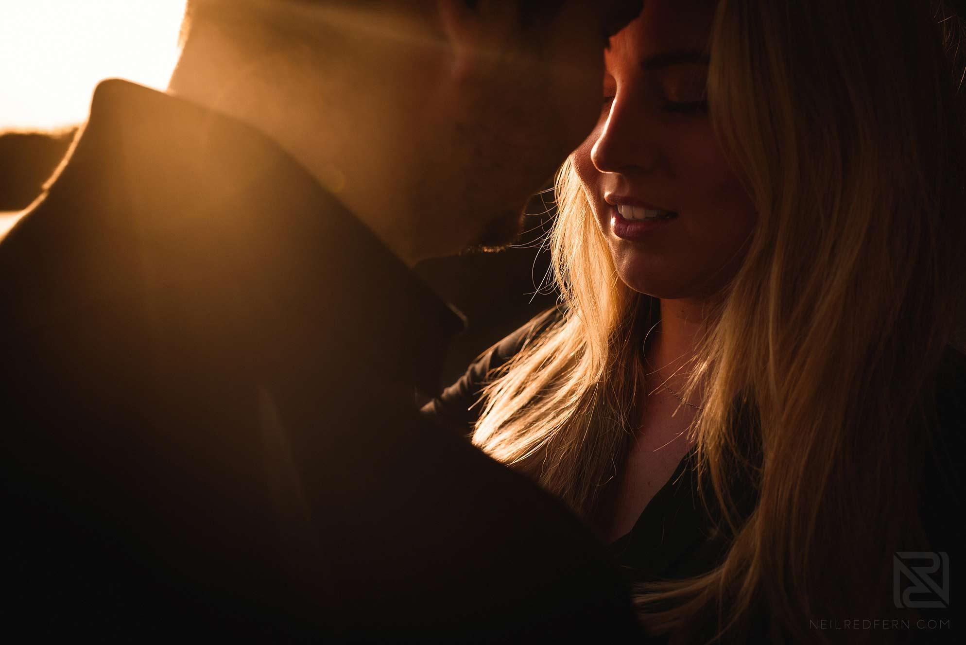 portrait of couple taken at sunset at Entwistle Reservoir