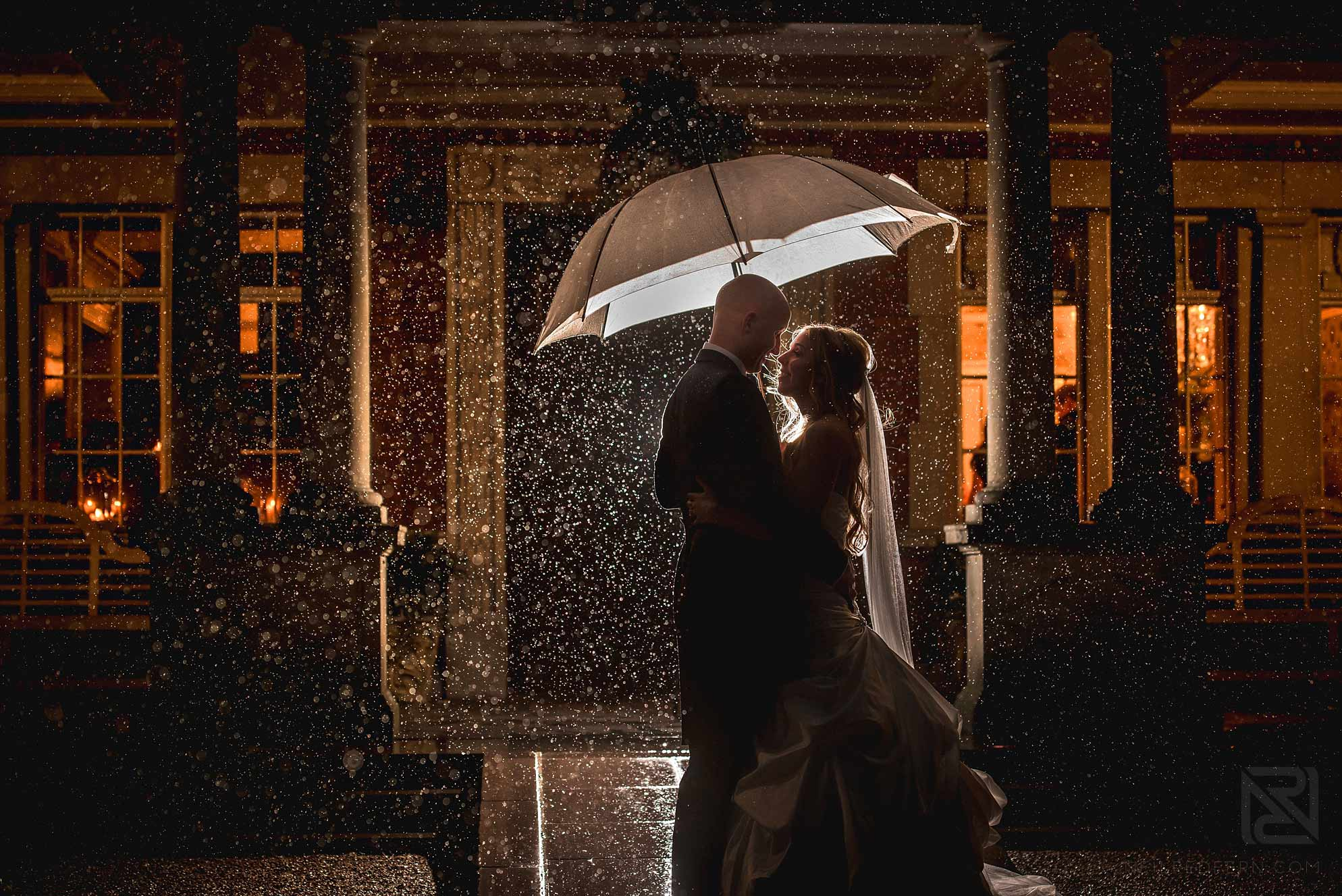 romantic photograph of bride and groom in the rain