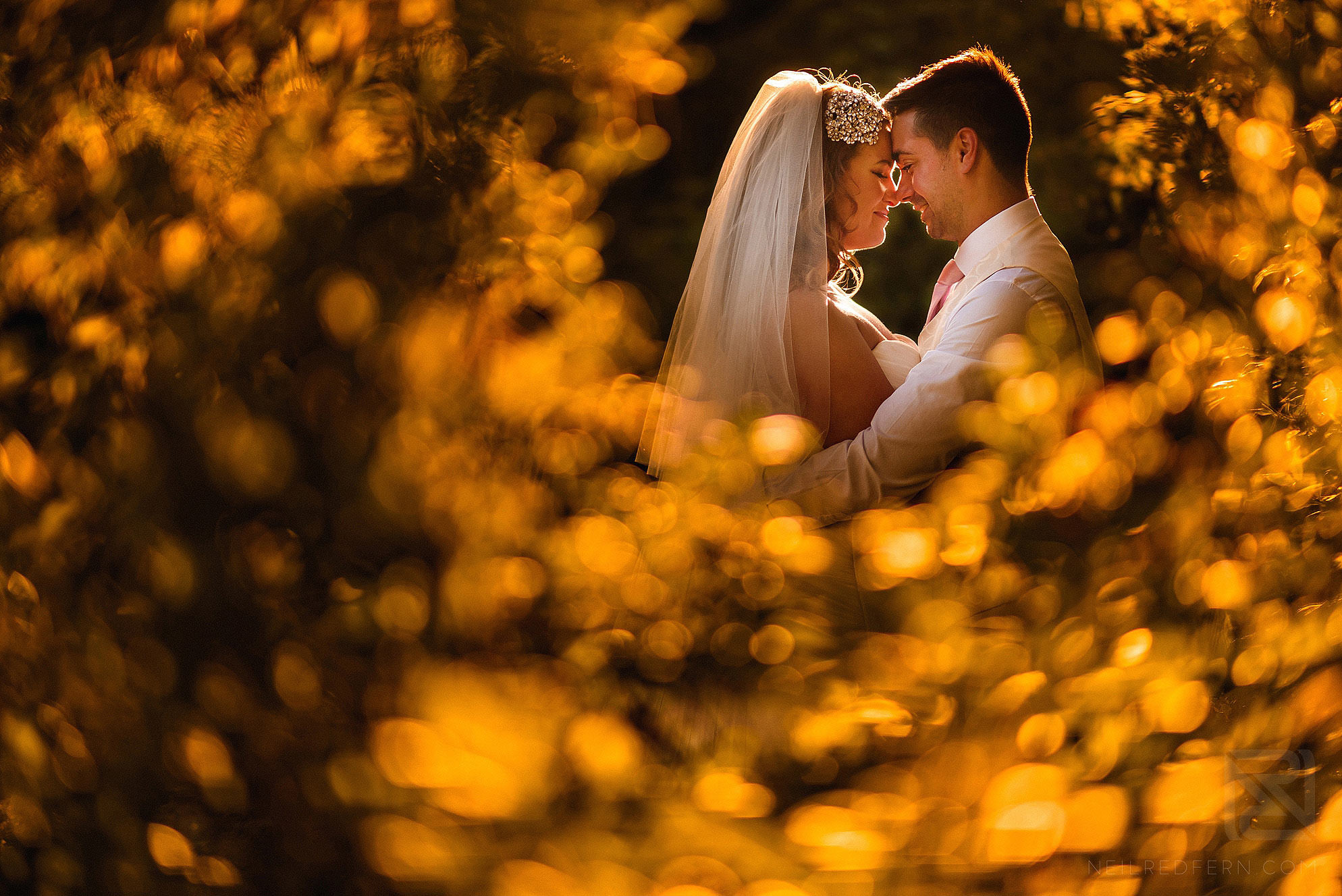 creative photograph of bride and groom at Eaves Hall