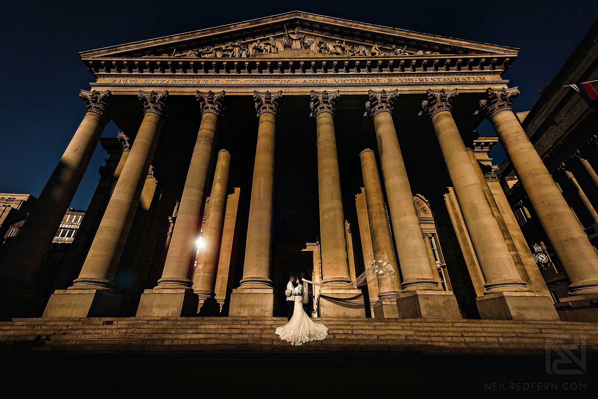 bride and groom on steps of Royal Exchange London