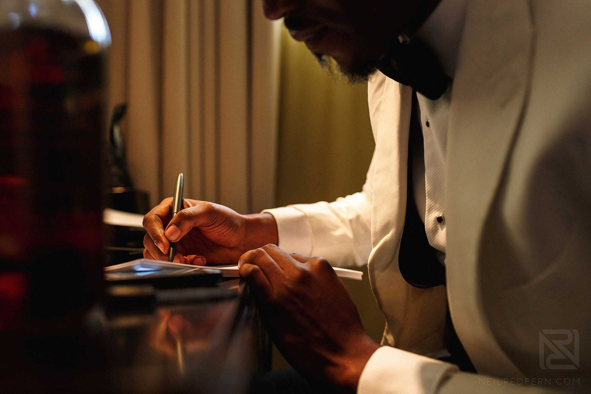 groom writing letter to bride
