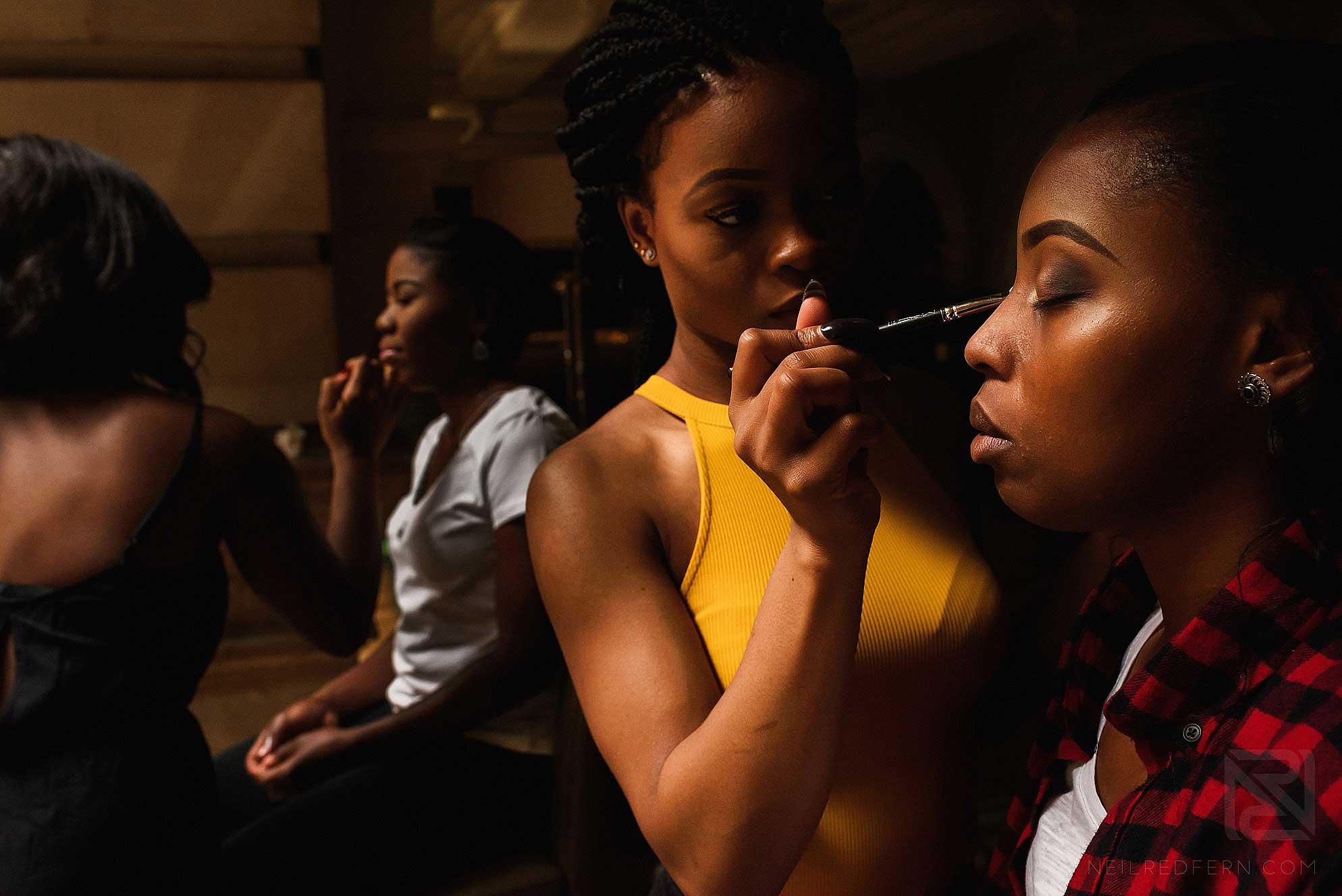 bridesmaids having make-up put on
