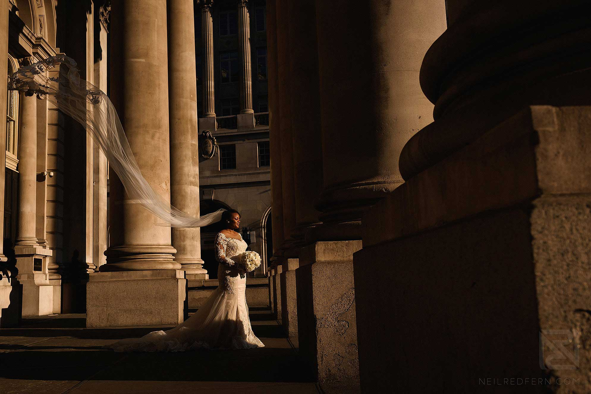 bride with long veil blowing in wind