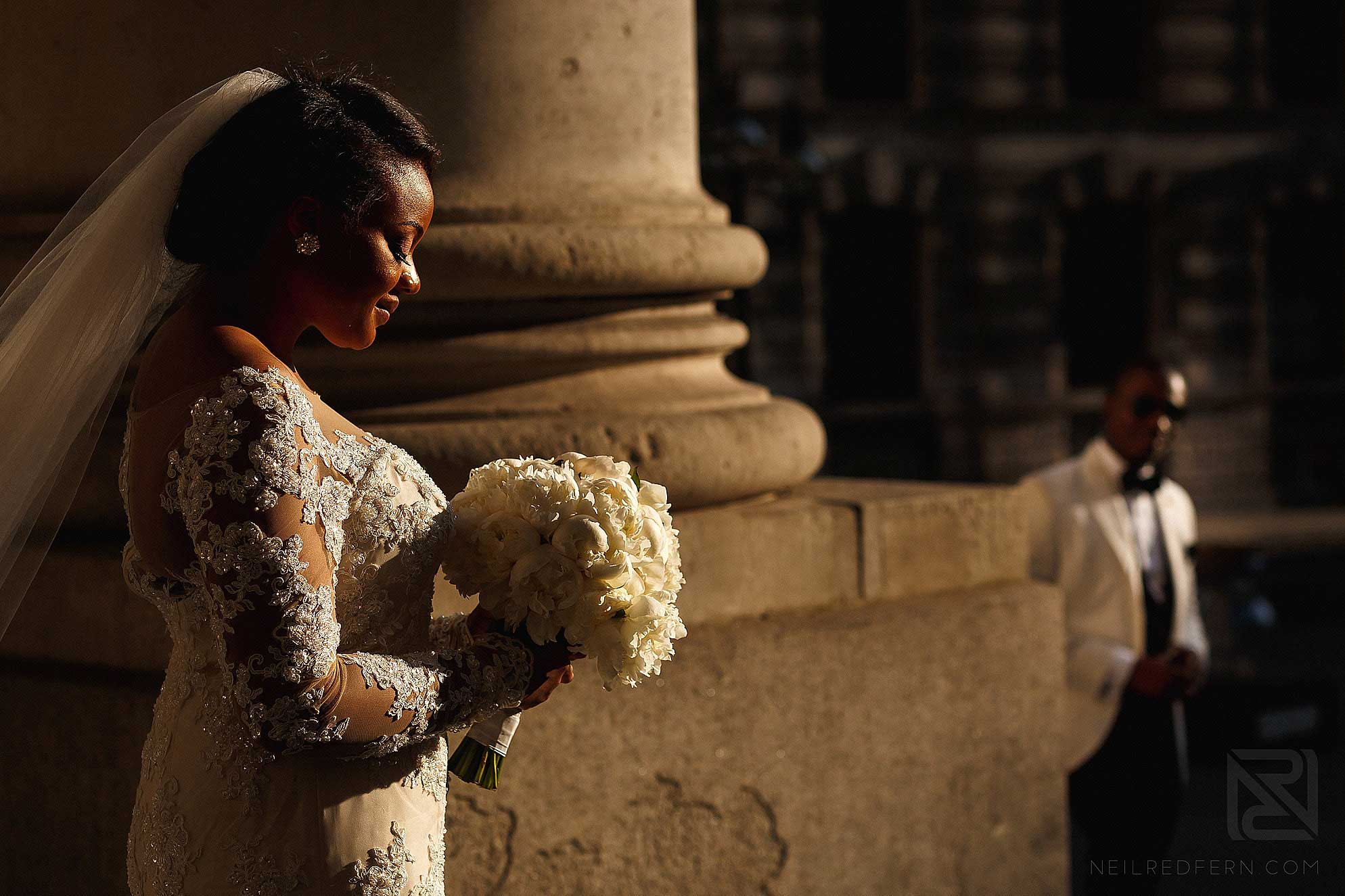 bride and bouquet on steps of Royal Exchange London