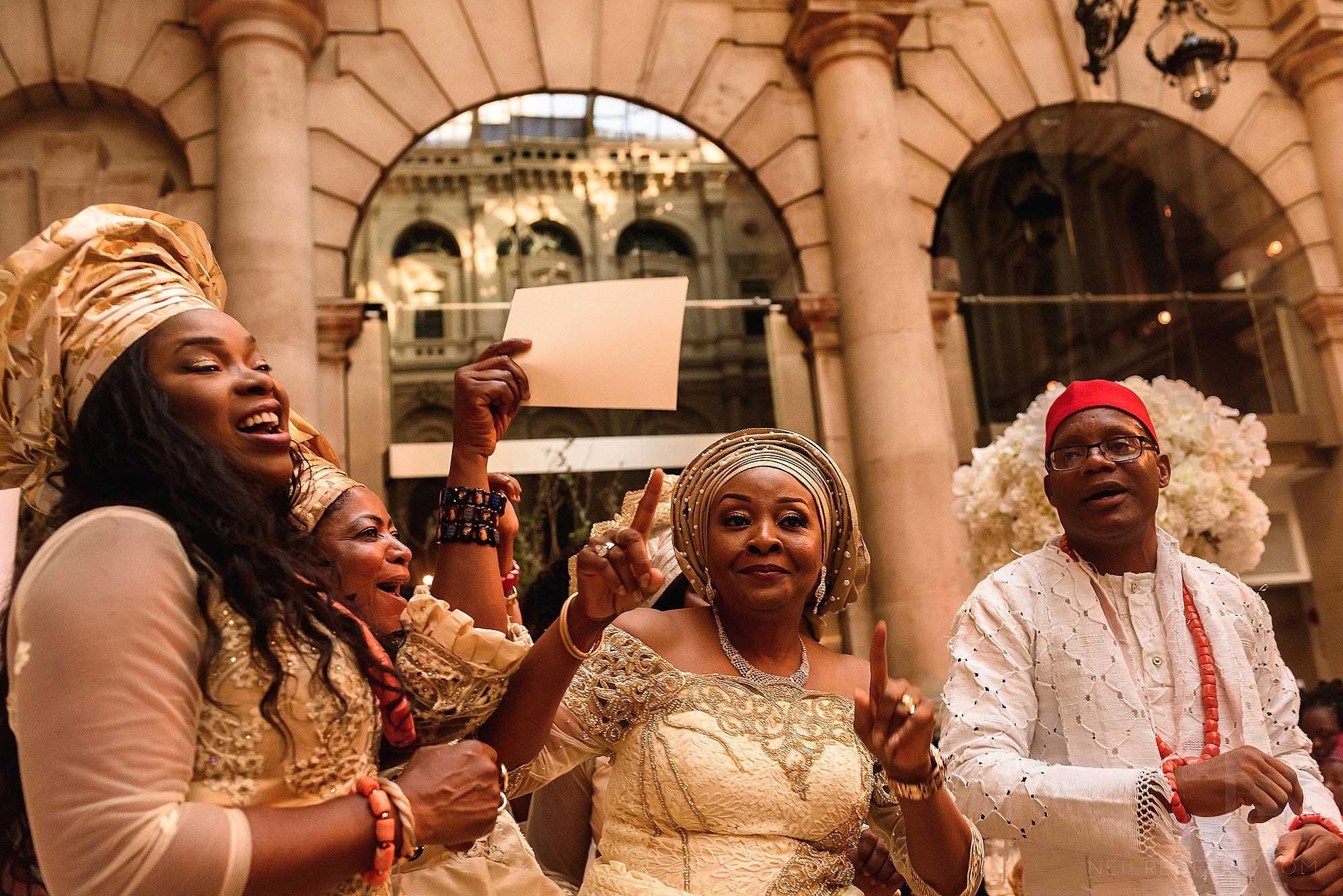 Nigerian wedding party dancing