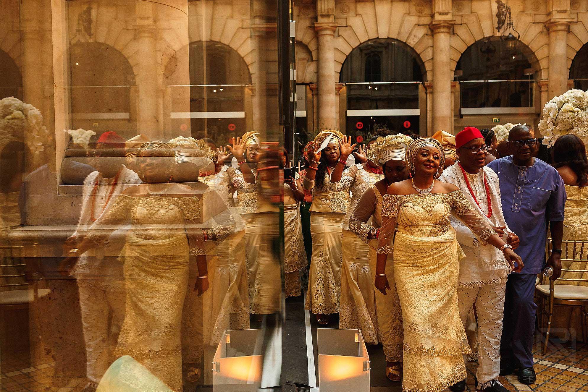 guests dancing in to Nigerian wedding