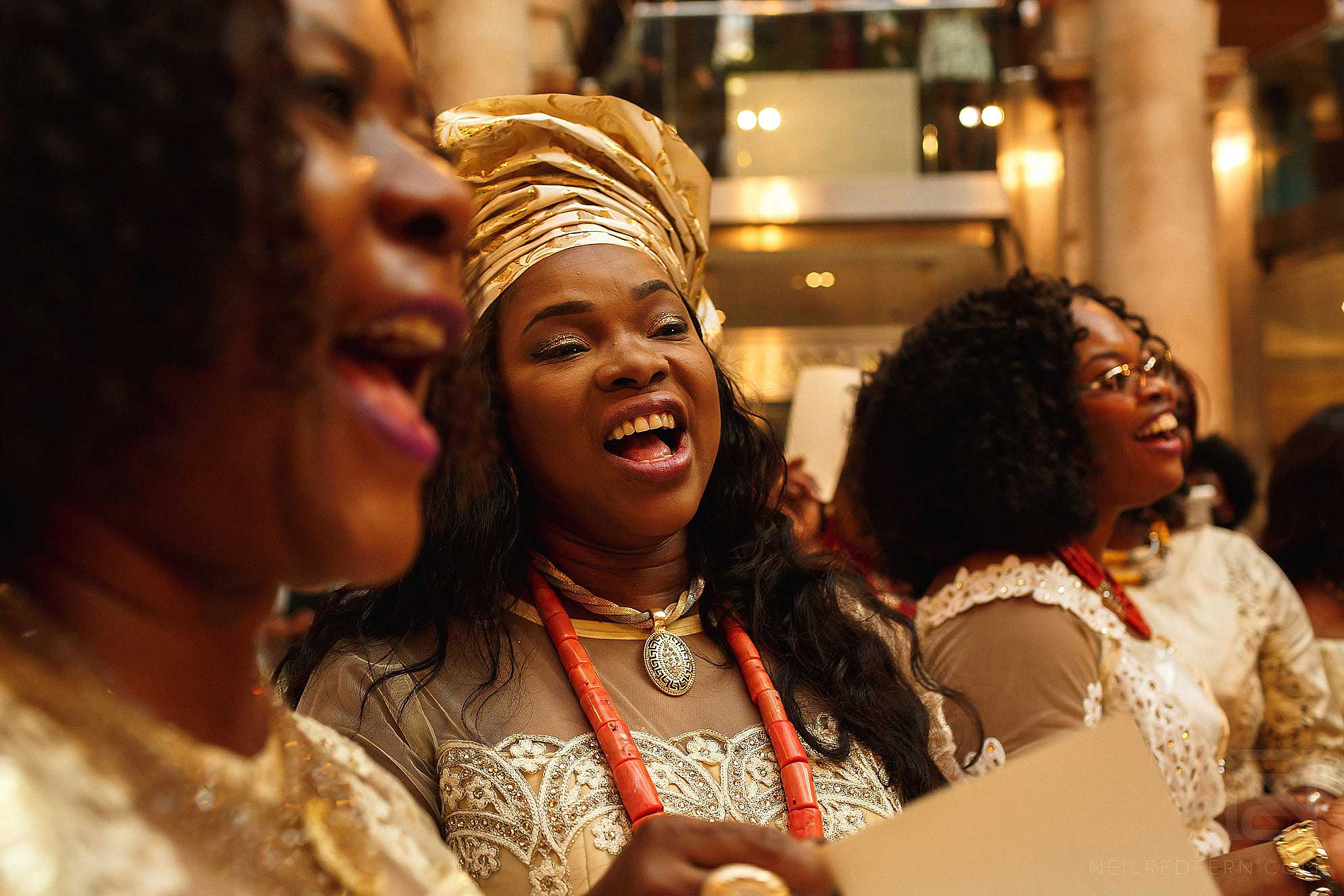 guests singing at Nigerian wedding at Royal Exchange London