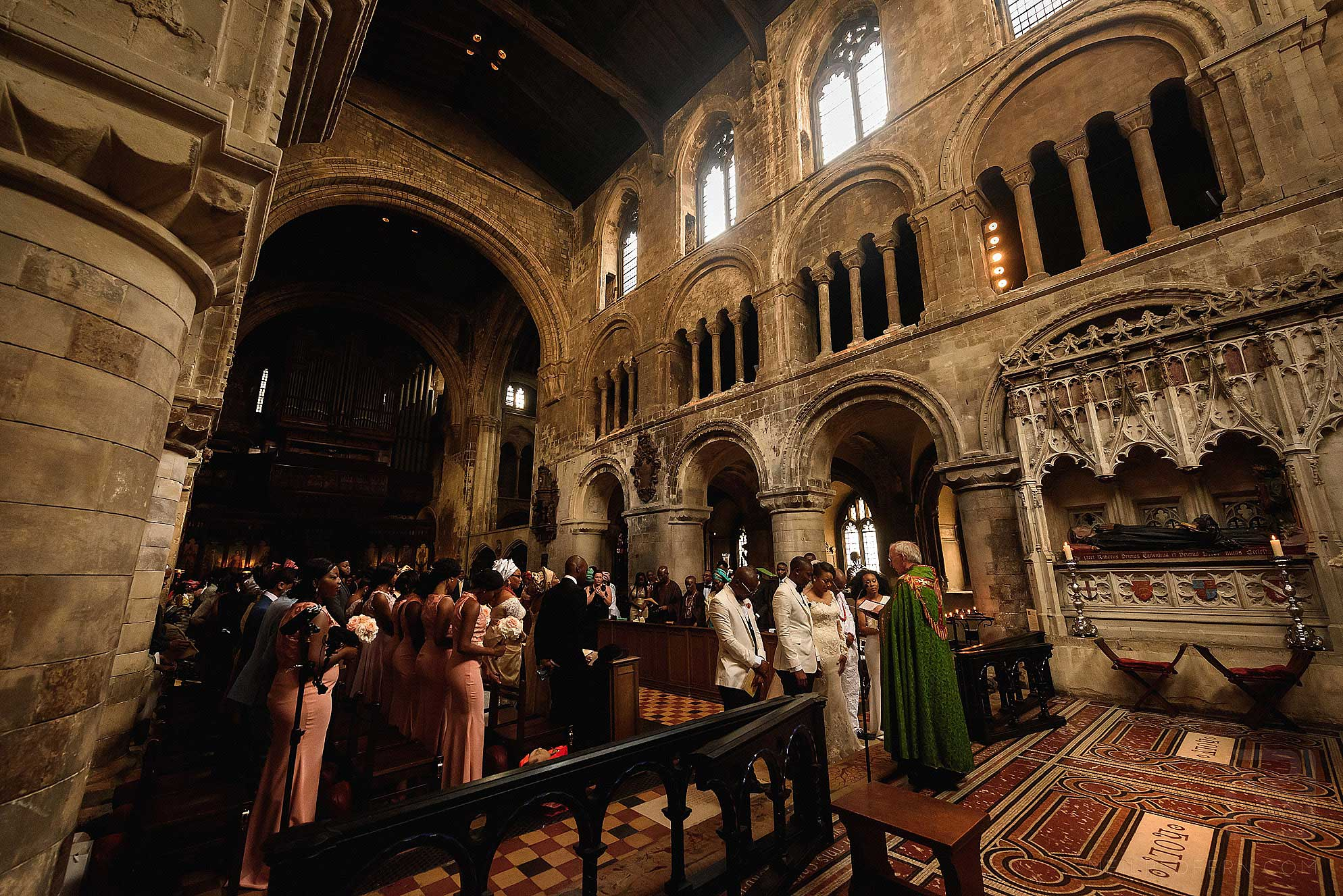 wedding ceremony at St Bartholomew the Great church in London