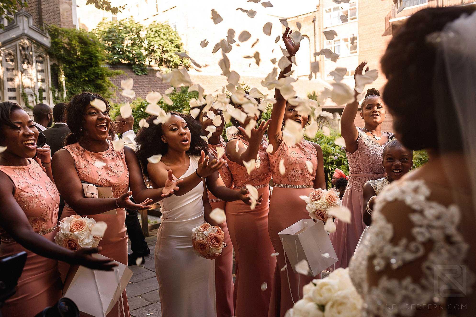 Bridesmaids throwing confetti