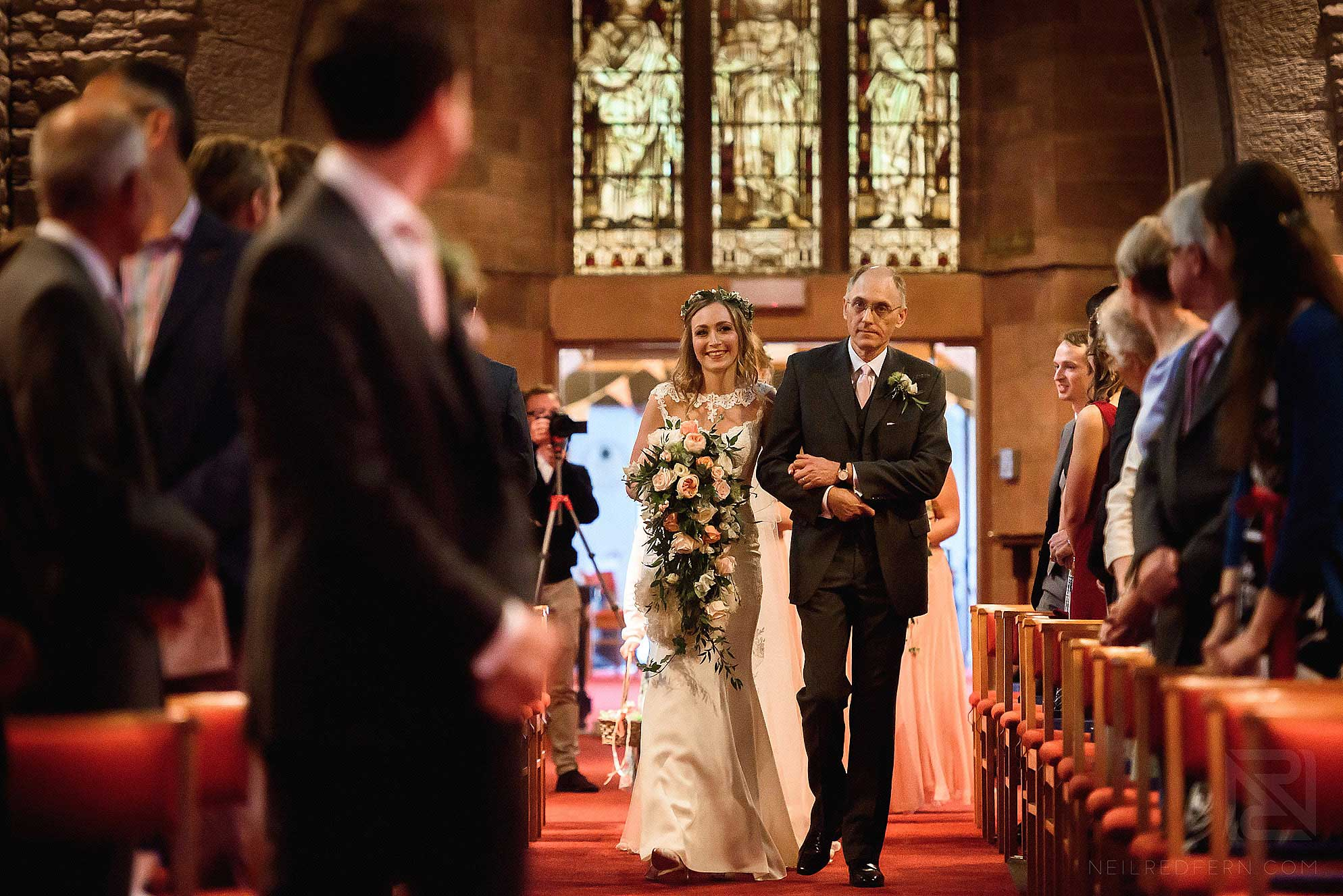 bride walking down the aisle in church