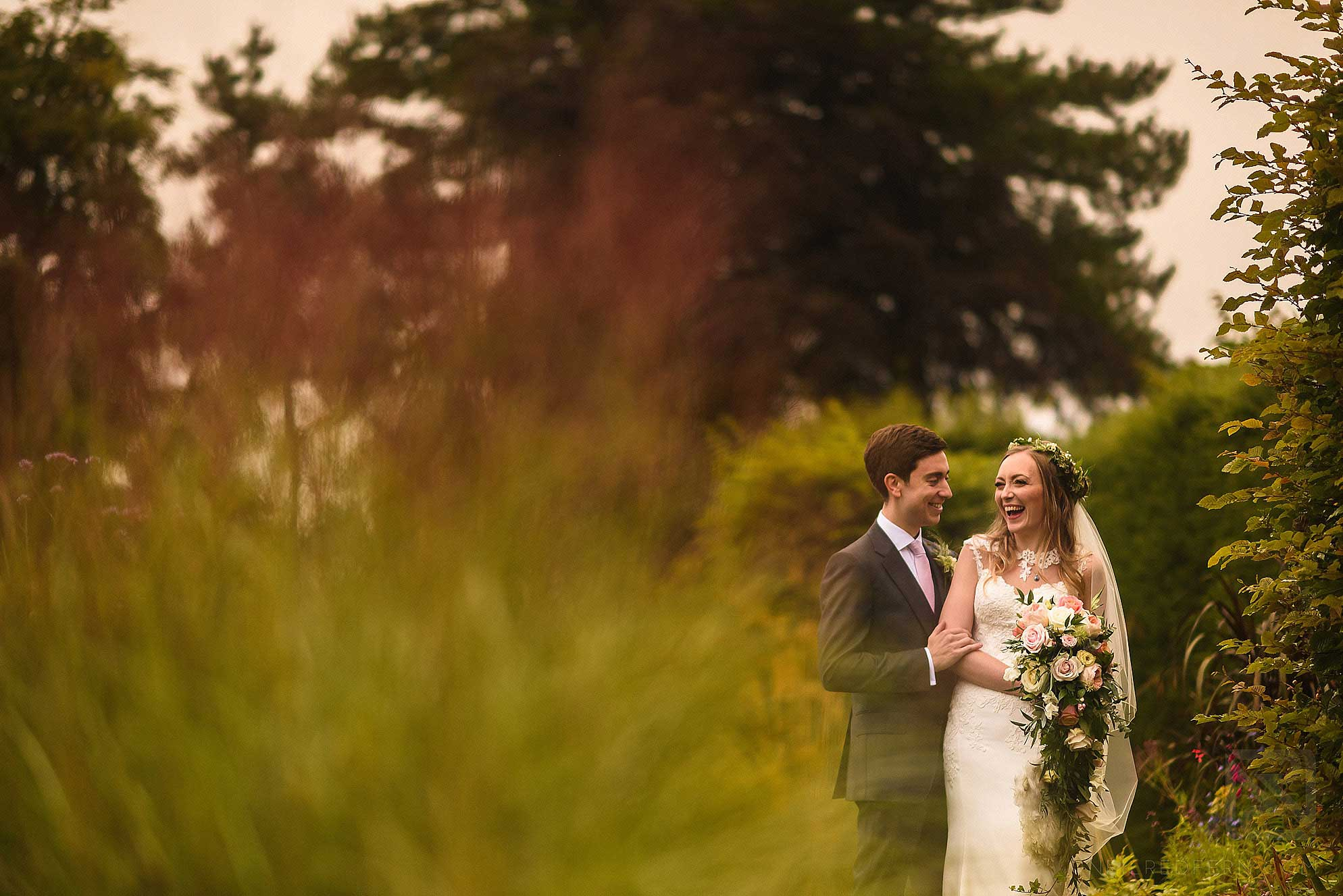 bride and groom laughing in Abbeywood Estate