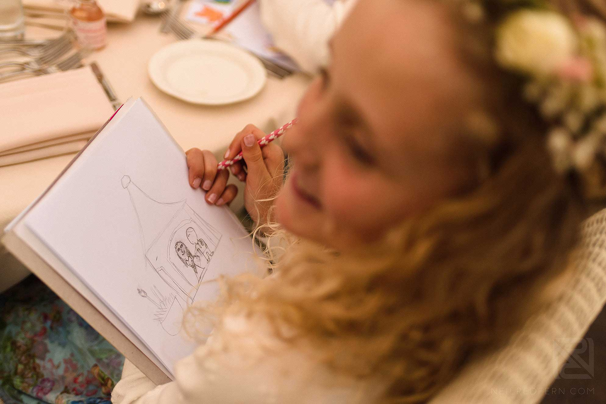 flower girl drawing a picture