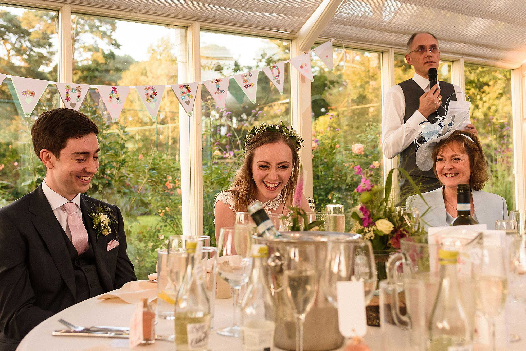top table laughing during speeches