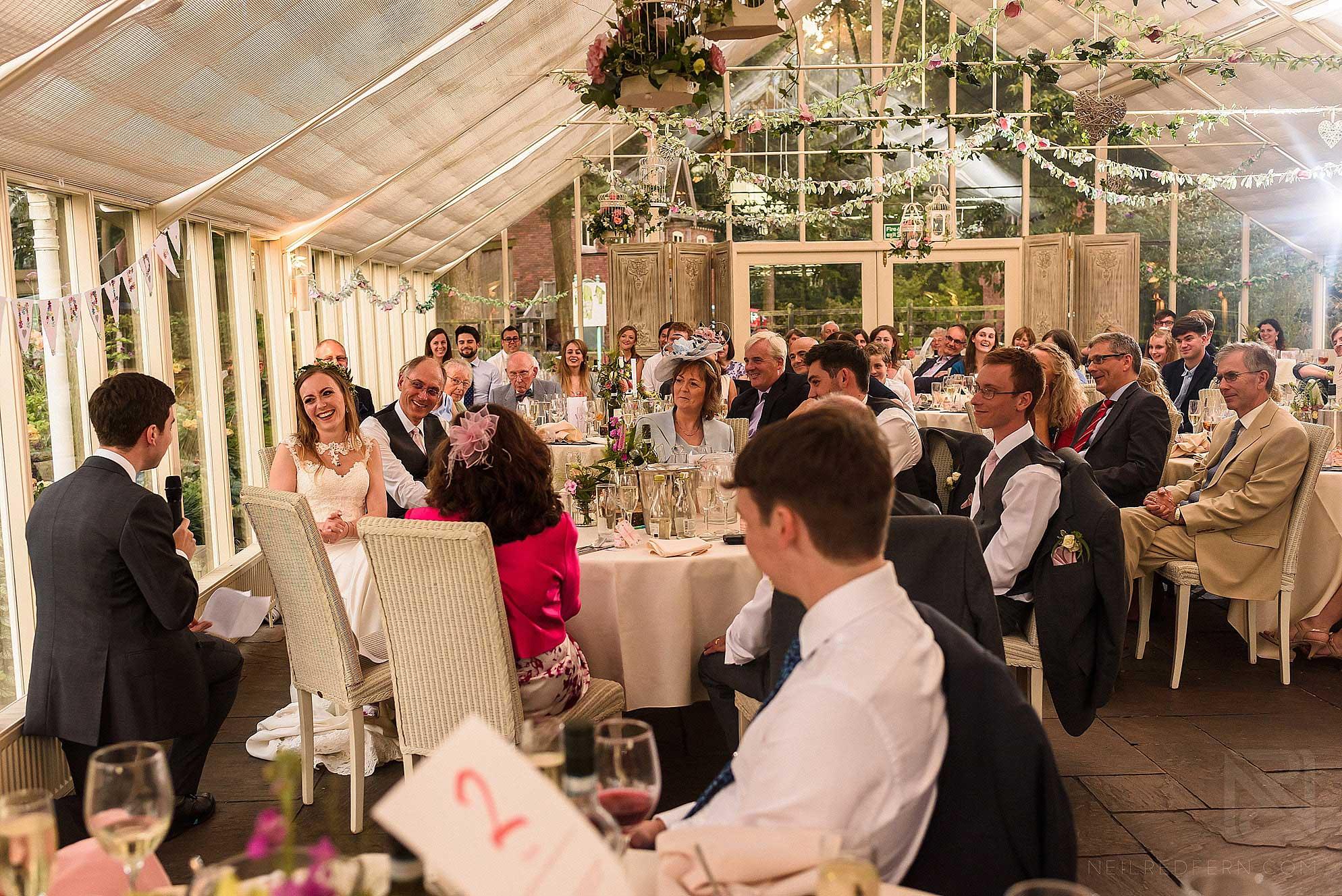 wide photograph of wedding speeches