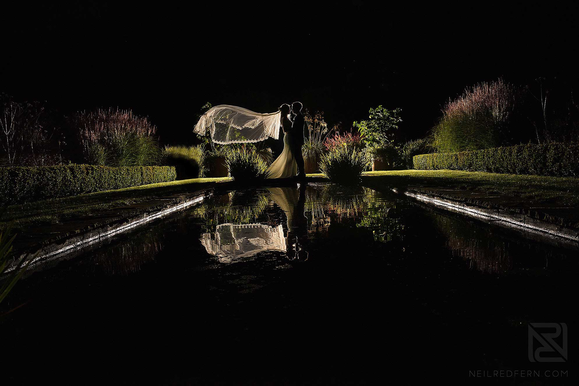 night time portrait of bride and groom at Abbeywood Estate