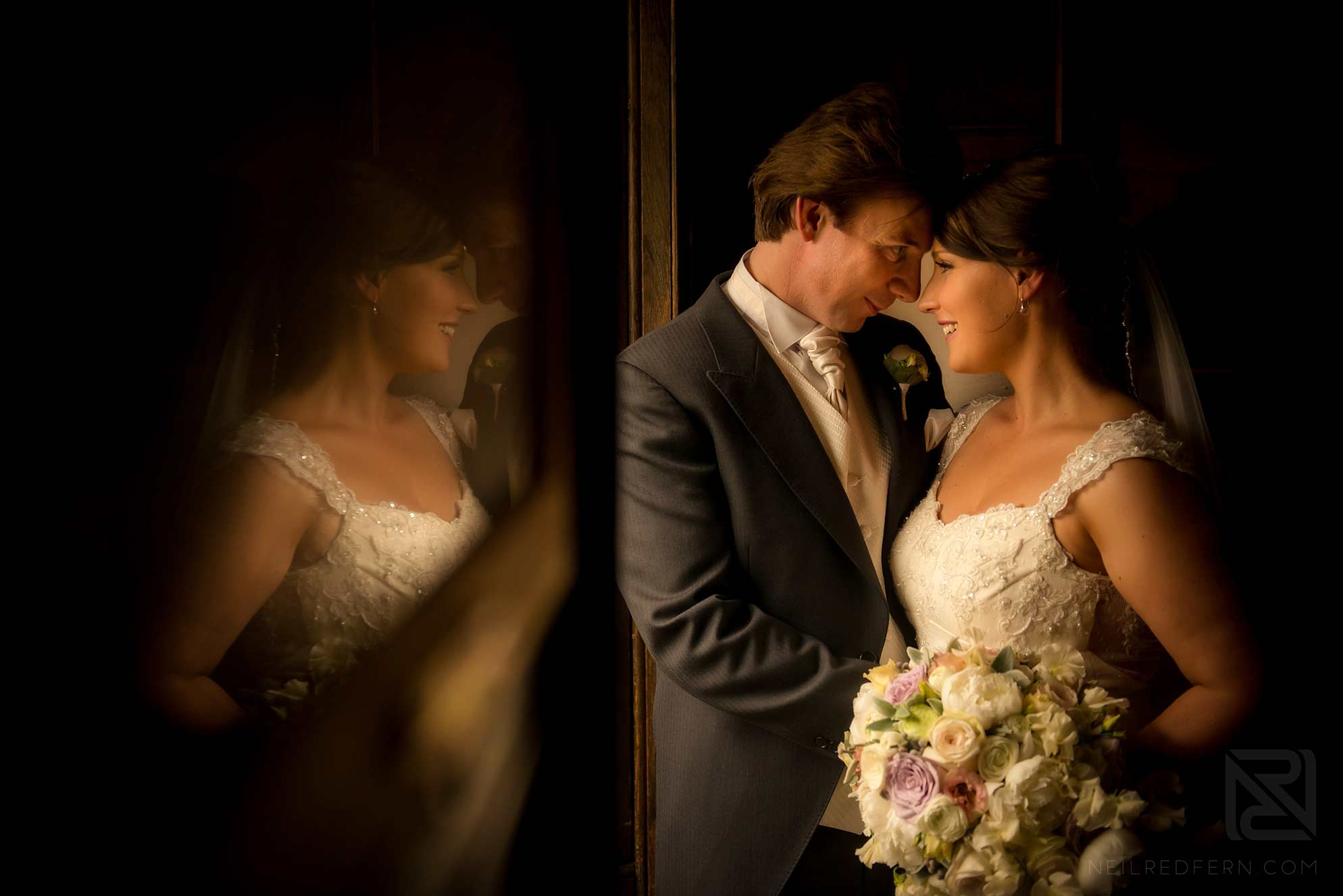 photograph of bride and groom with reflection in mirror