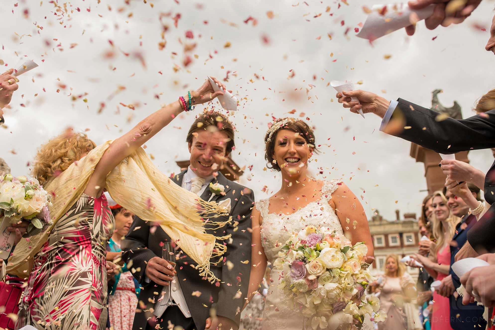 bride and groom laughing with confetti