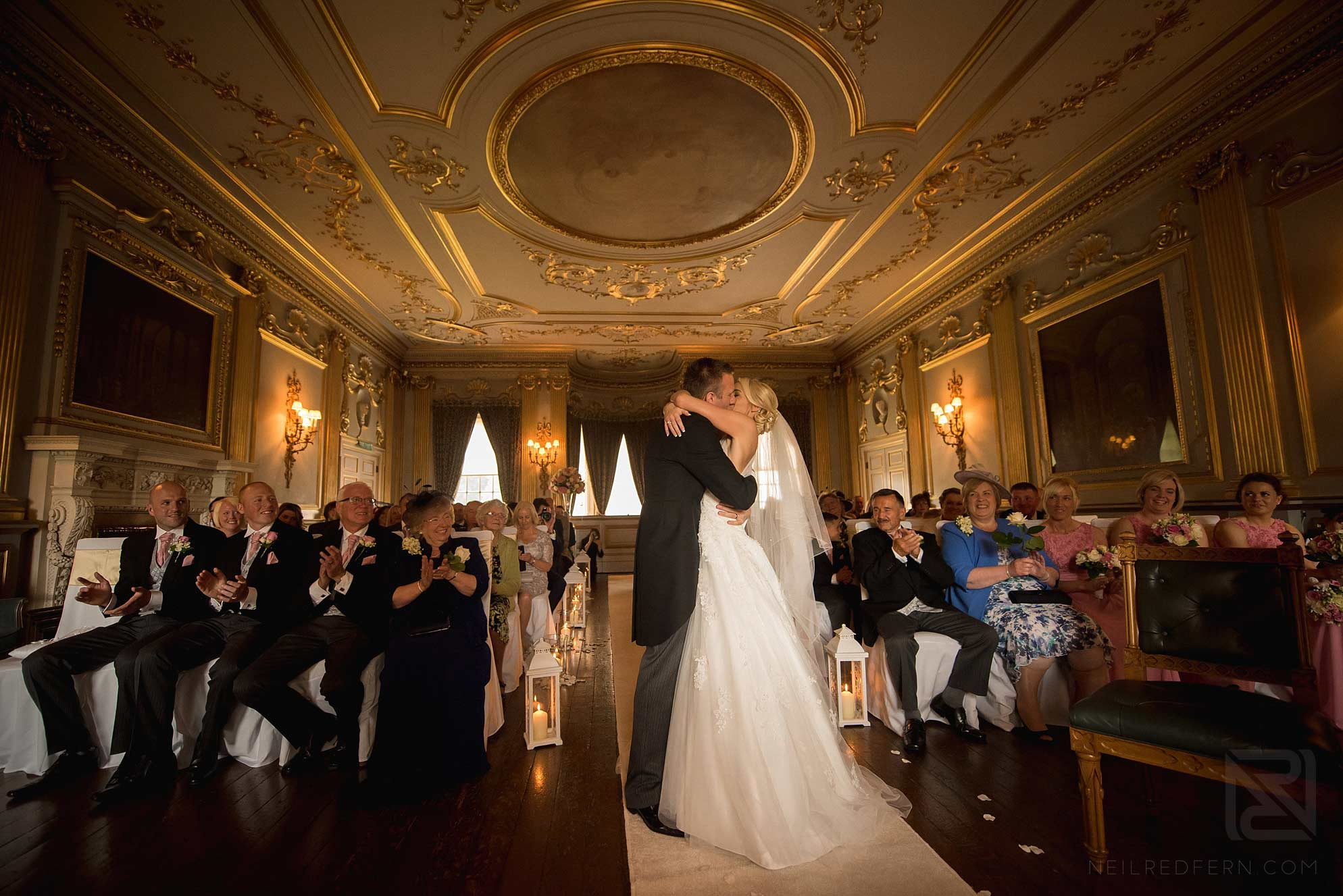 first kiss during wedding ceremony at Knowsley Hall