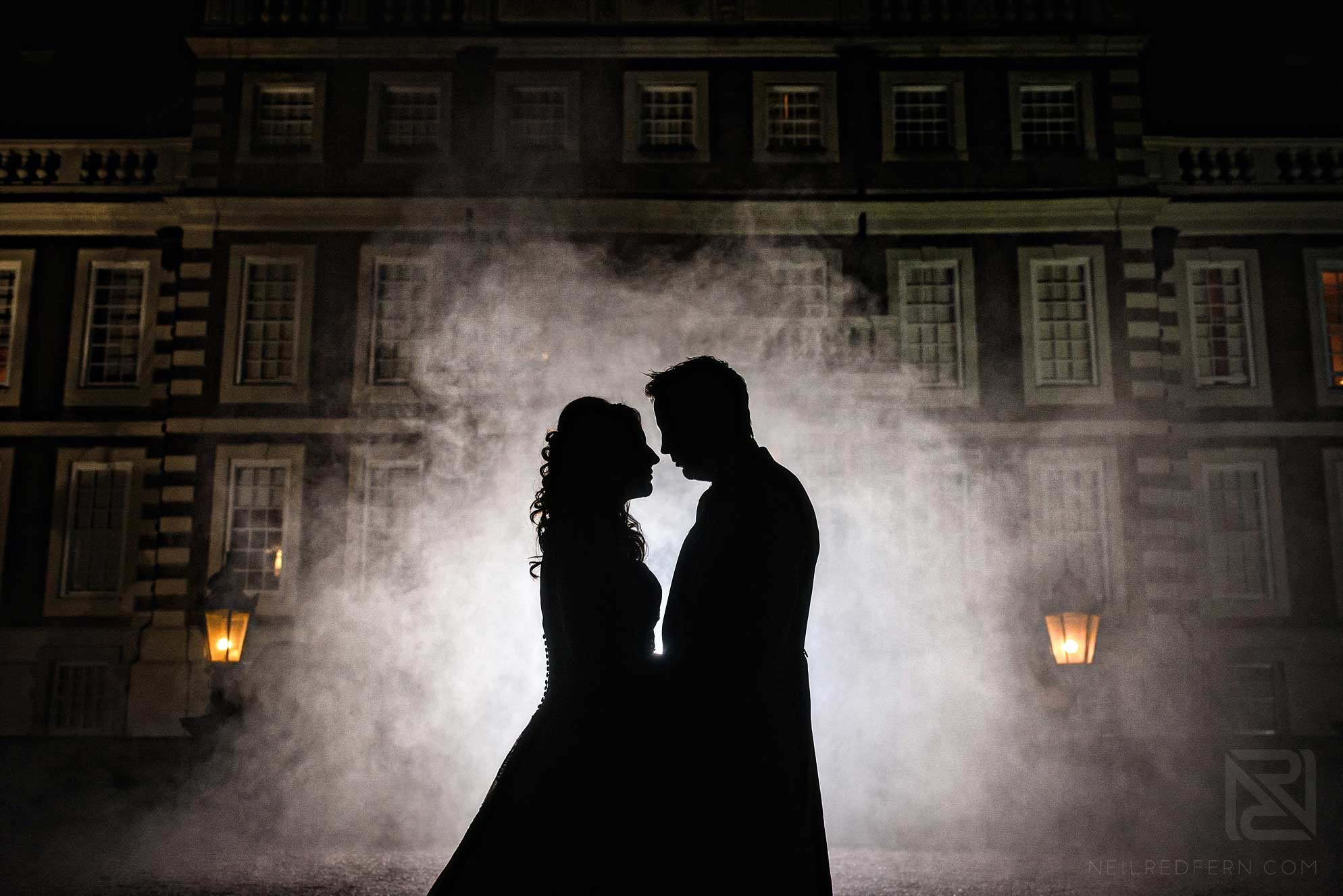 creative wedding photograph of bride and groom with smoke