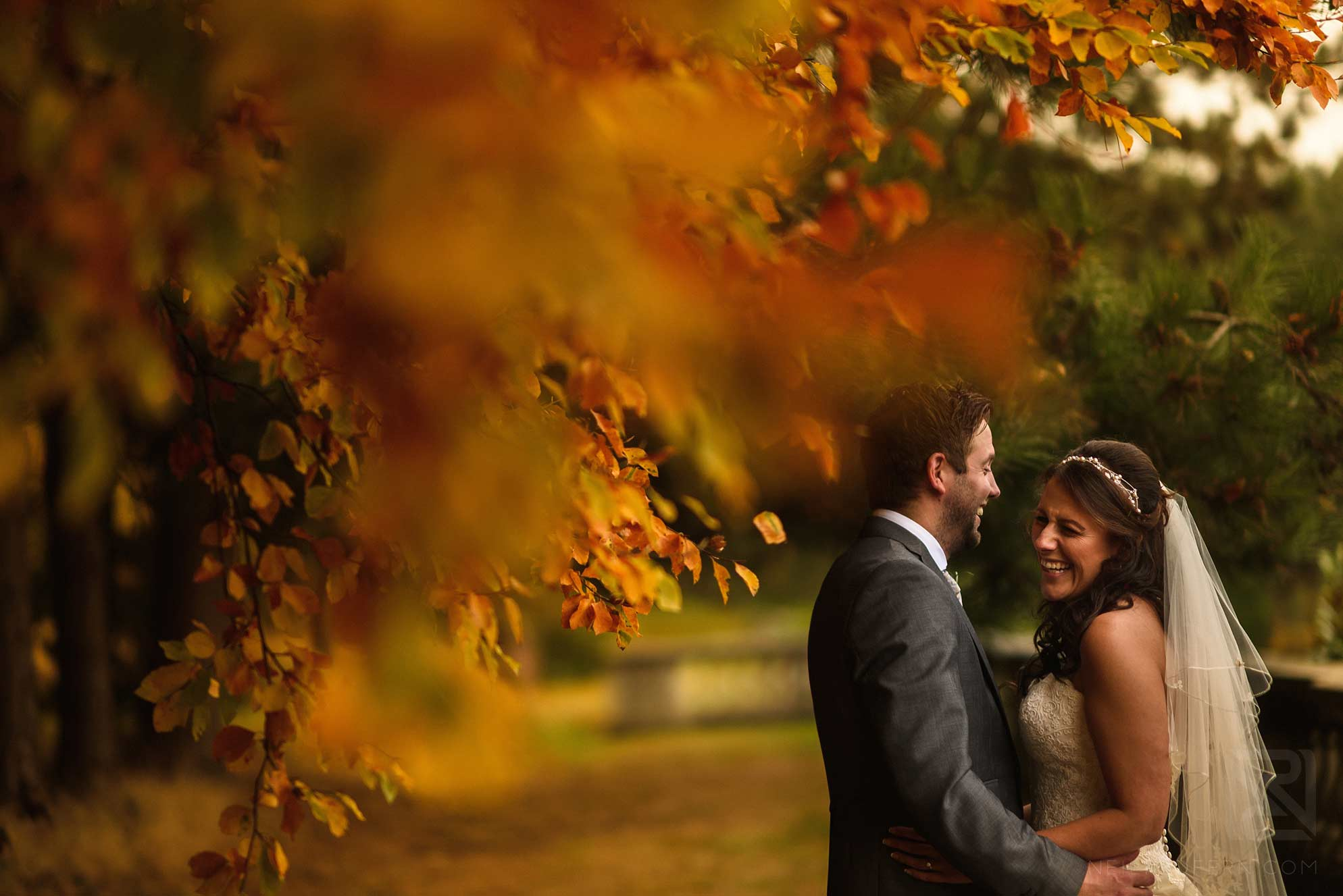 portrait of bride and groom in autumn