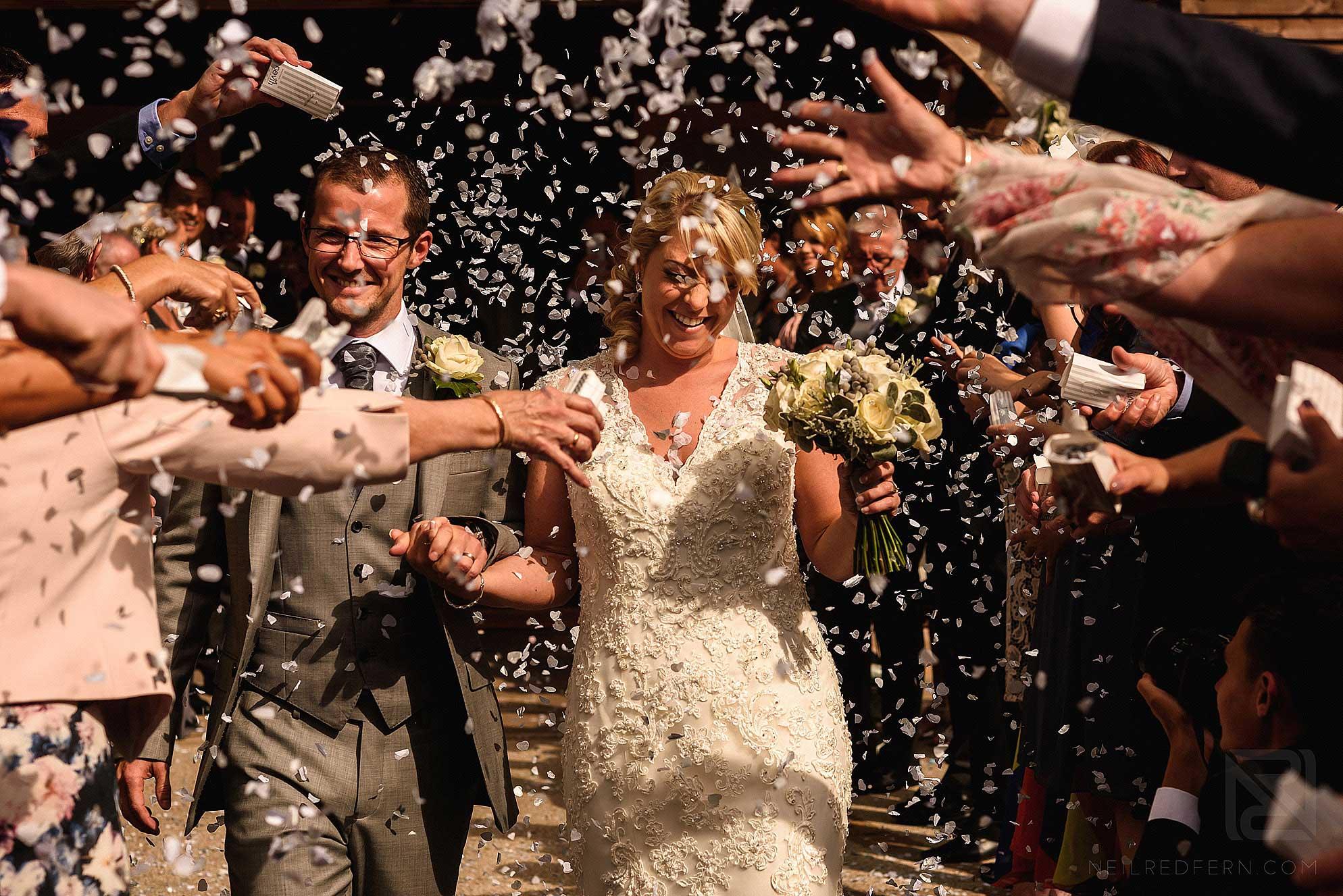 throwing confetti at wedding