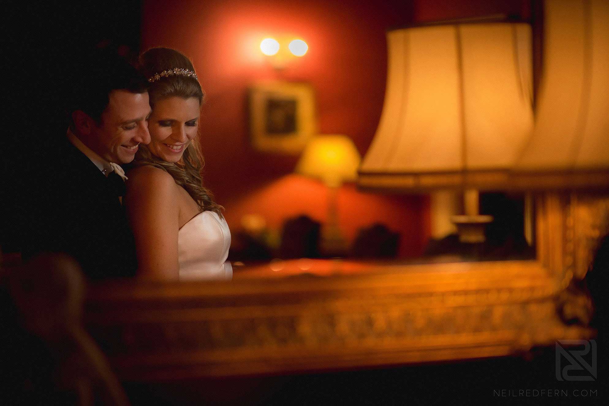 bride and groom photograph in mirror