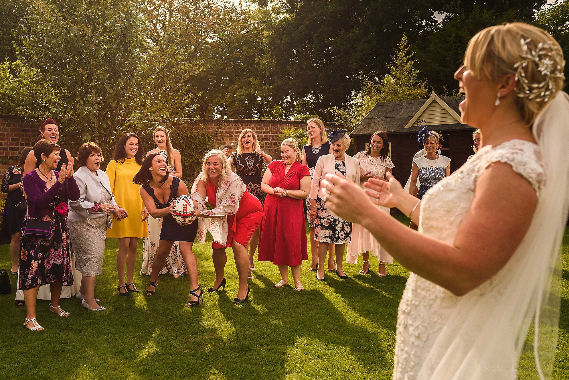bride throwing rugby ball