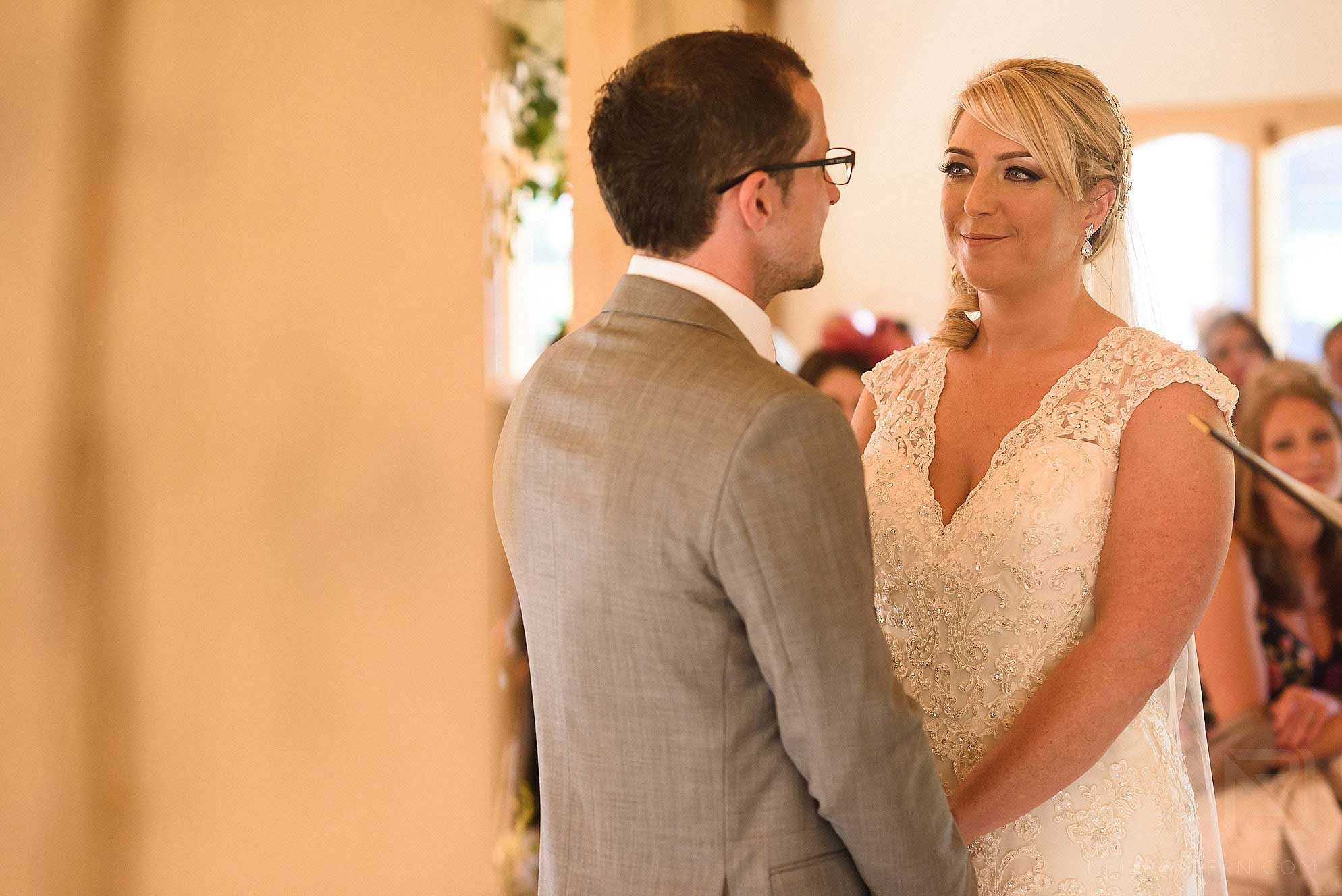 bride and groom saying vows during ceremony