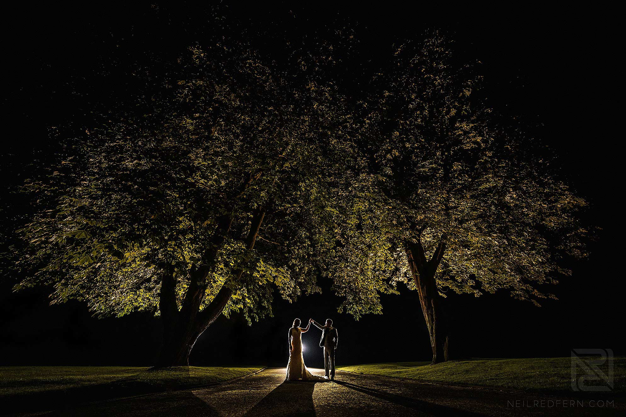evening portrait with flash of bride and groom