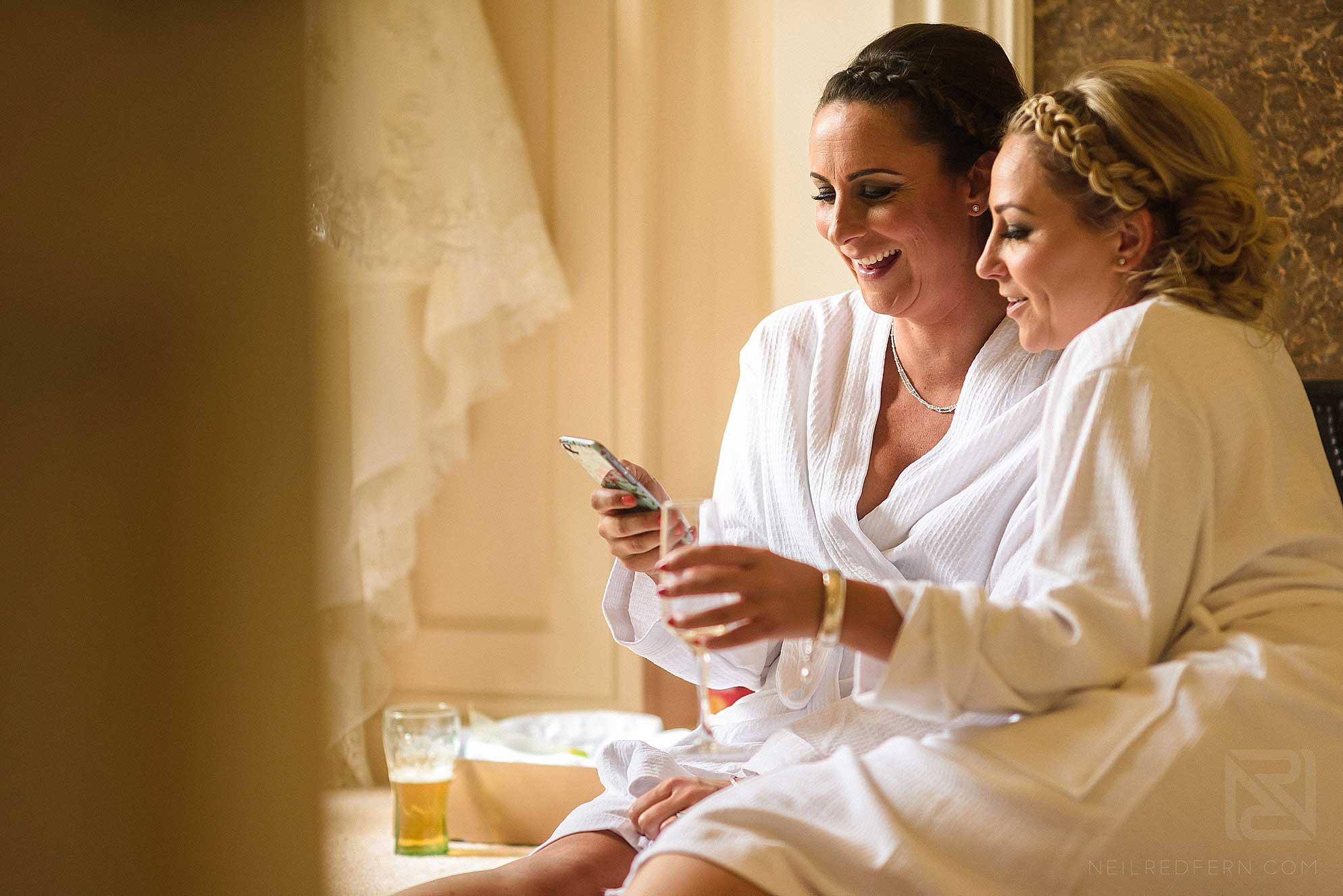 bridesmaids laughing at phone