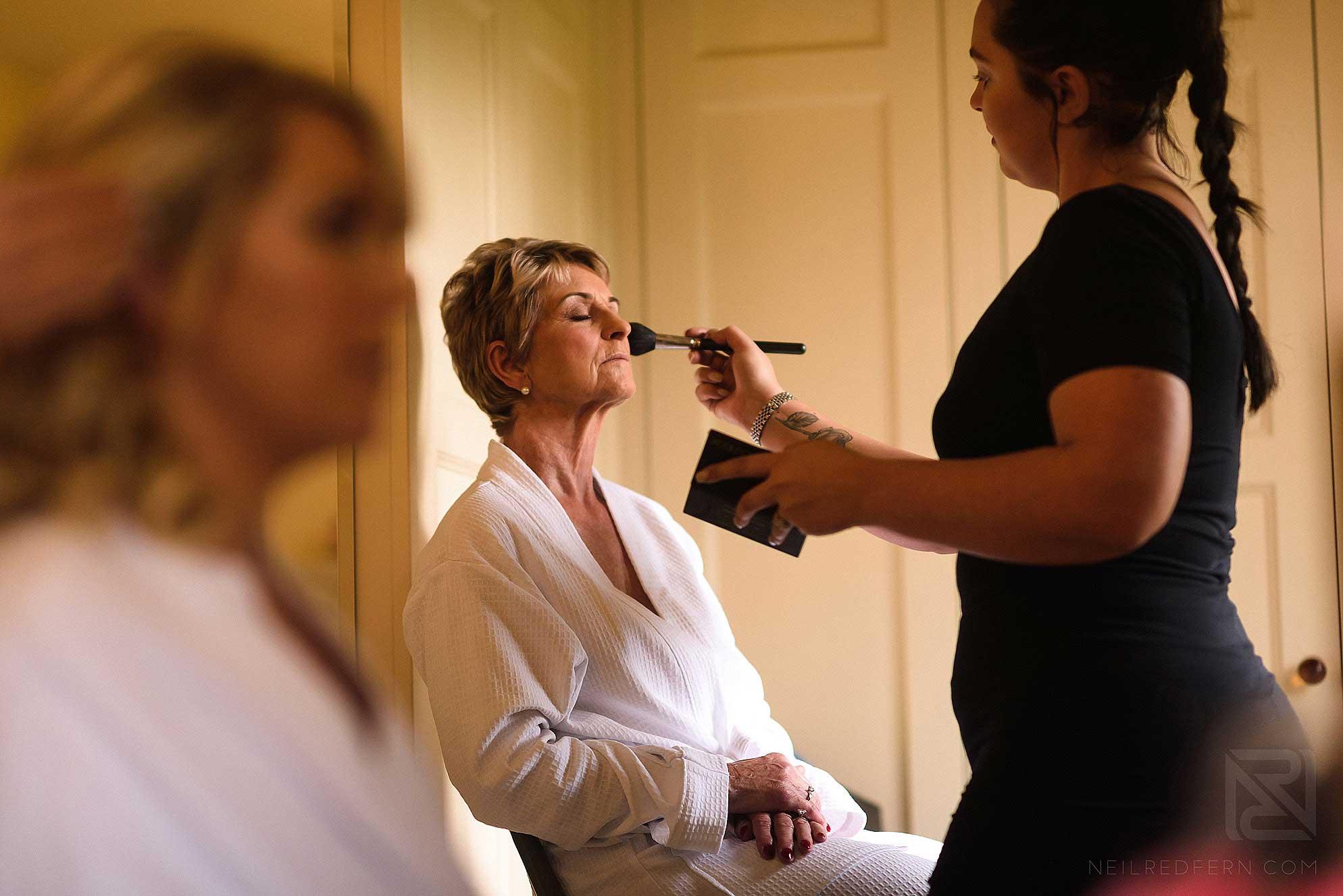 mother of bride having make-up done