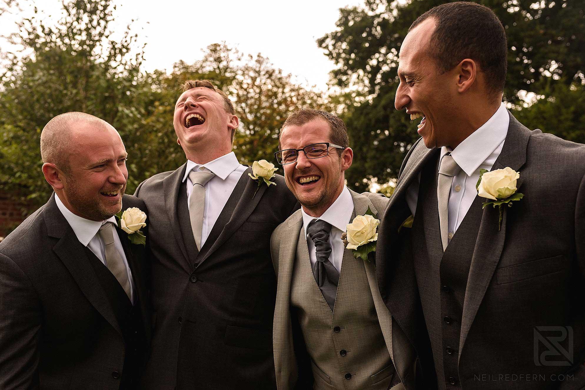 happy groomsmen at wedding