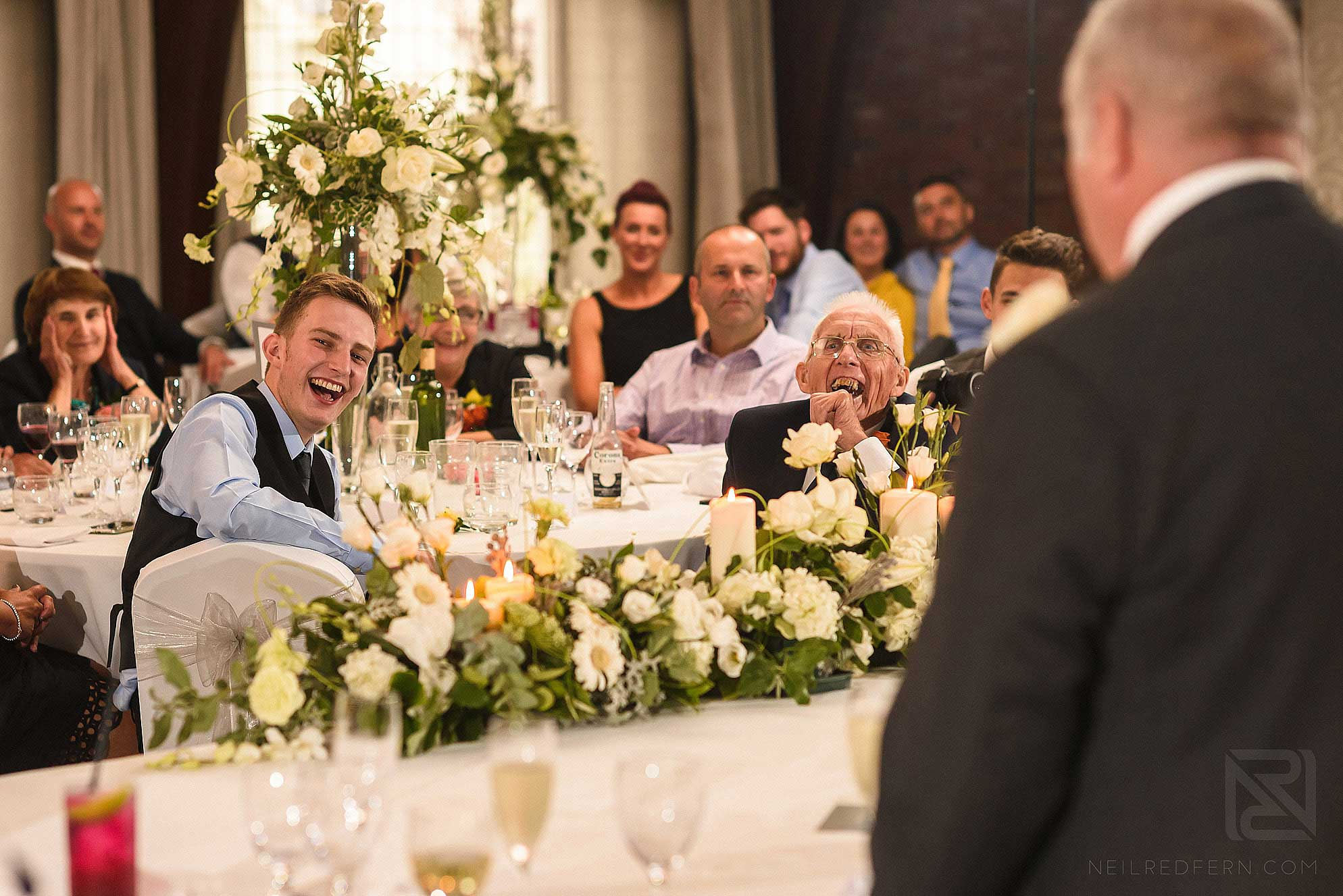 laughing wedding guests at Colshaw Hall